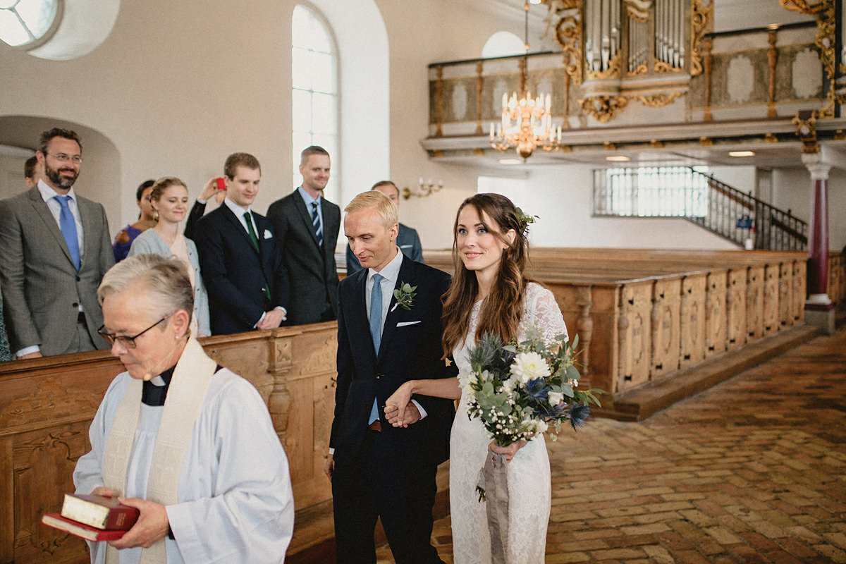 Bride and groom enters church