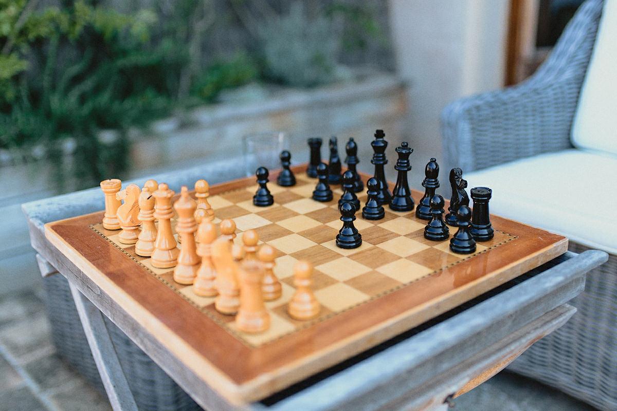 Groom and batsman playing chess