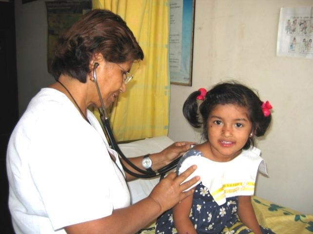 A nurse doing an annual checkup.  The medical team generally spends generously for the care of children and other patients seen in the clinic. This is necessary because there is very limited government funding for medical and surgical treatment, especially complicated cases.
