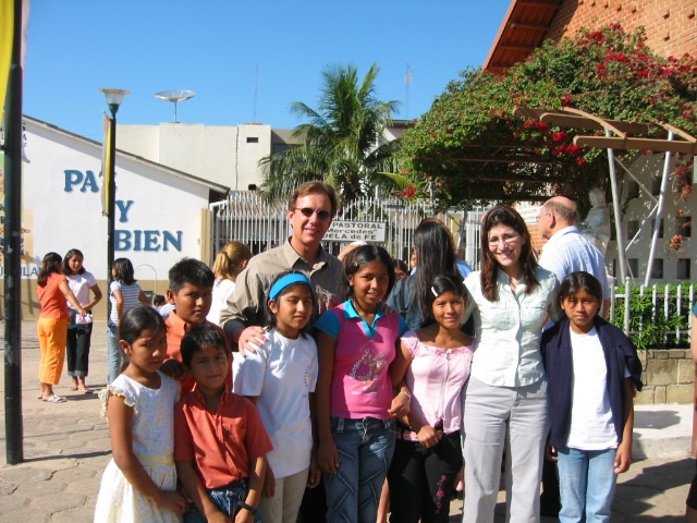 Volunteers and children outside of the orphanage which is located next to the Catholic church.