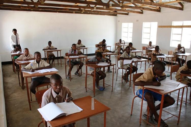 Grade 7 Boys writing exams in their new classroom.