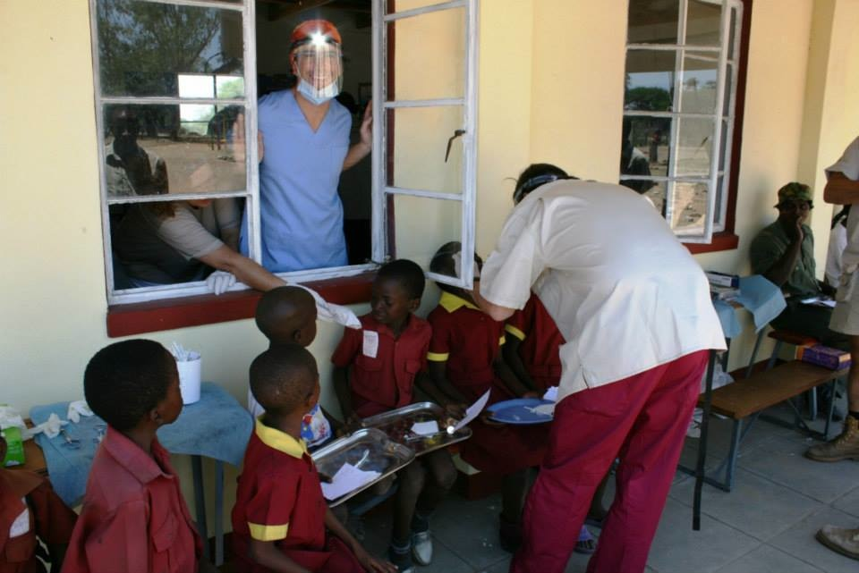 Diego checking school children at Ngamo to prep them for procedures.  Every year we do a clinic here to service communities along the Hwange Park boundary not accessible to our busses.