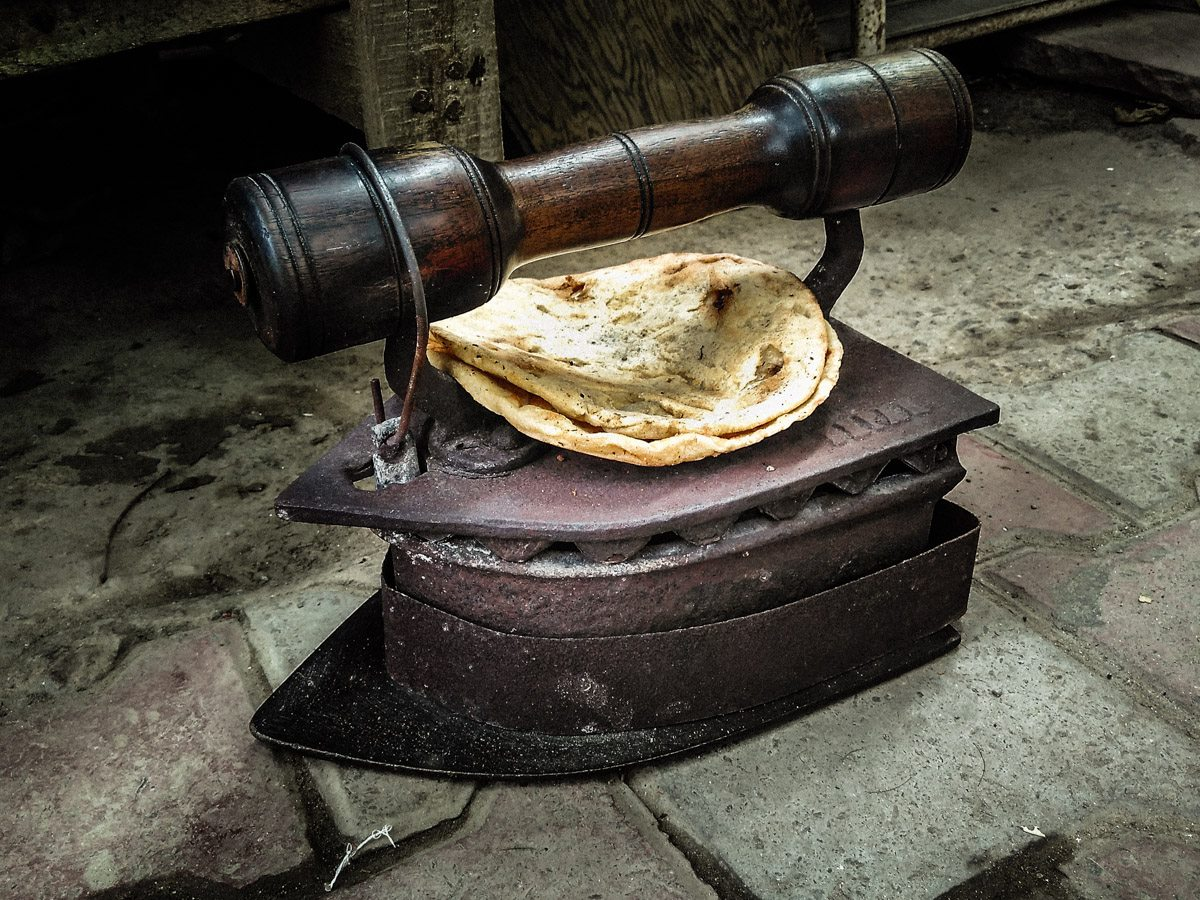A coal-powered iron and bread warmer.