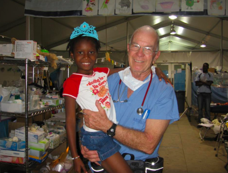 Dr. Miller with a child in Haiti after the 2010 earthquake.