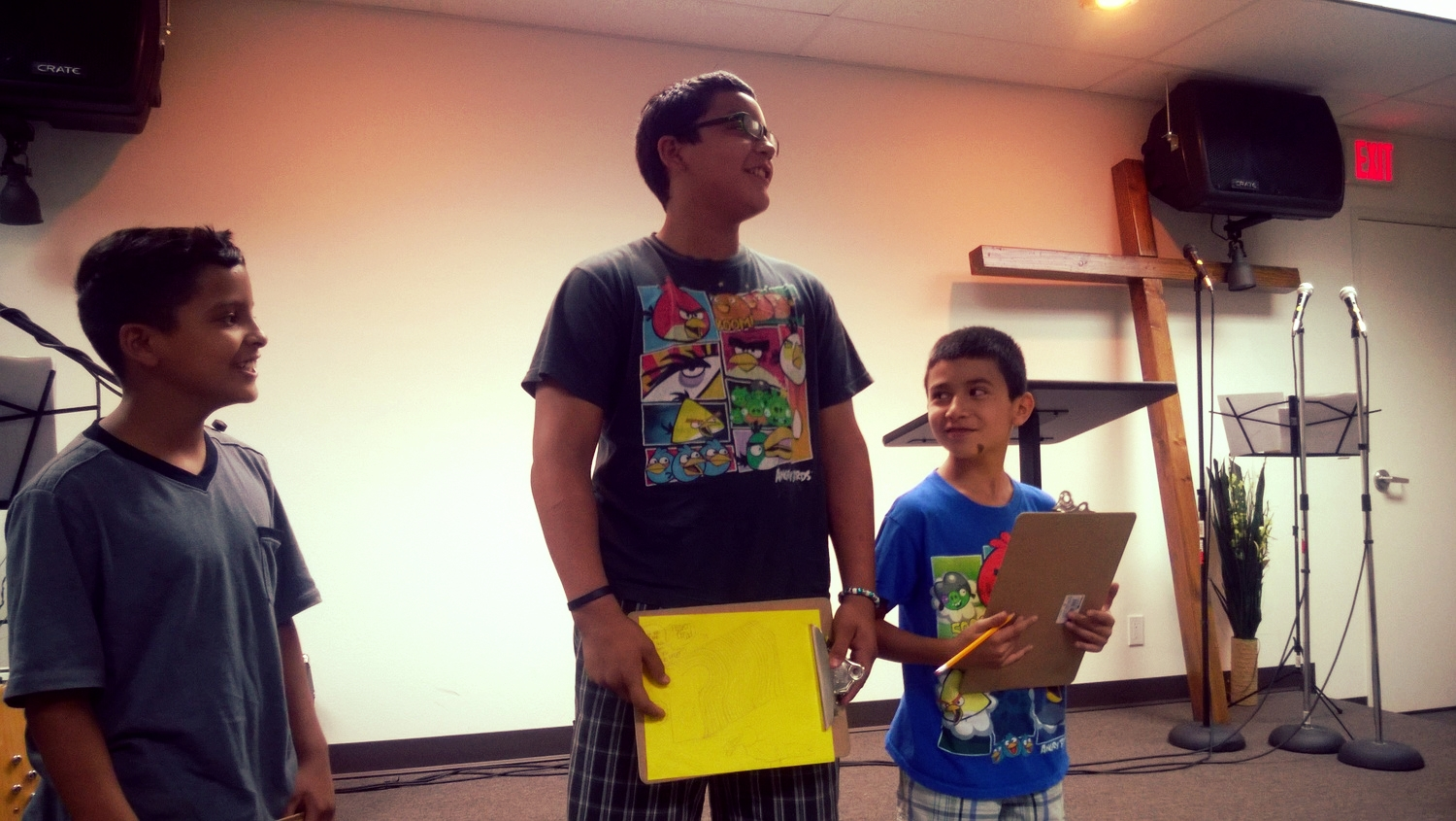 Students presenting their Bible verse drawings.
