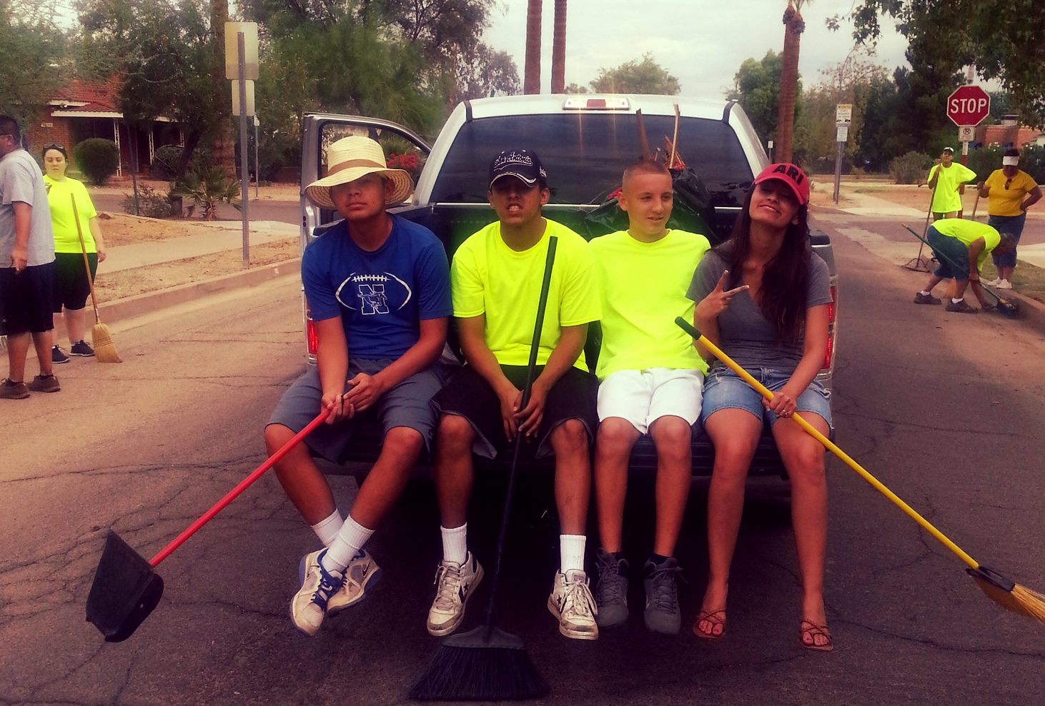 Thank you for spending the morning making the streets of Phoenix beautiful and putting a smile on the face of our neighbors! Just for the record, they did get off the truck!!