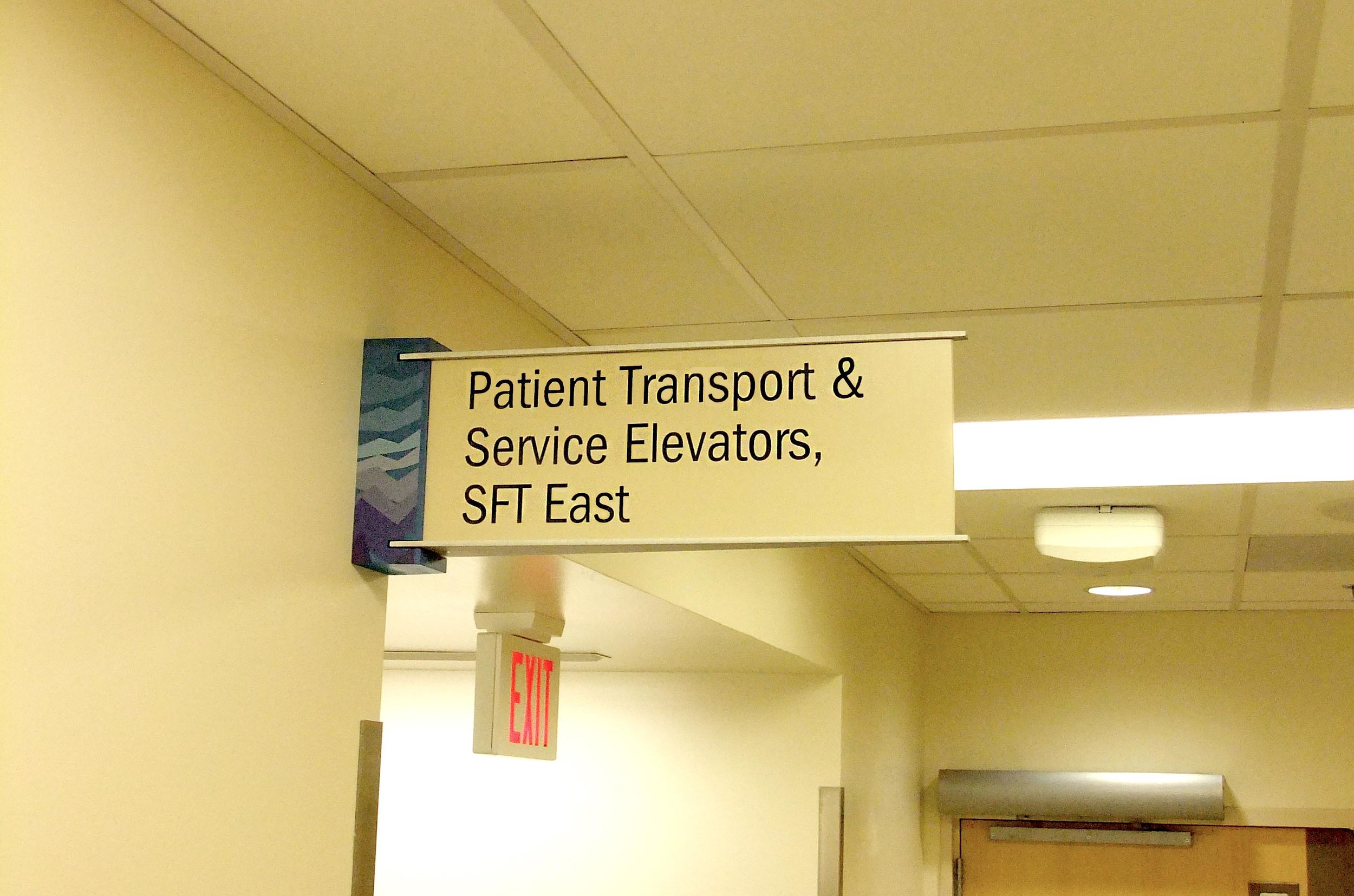 hostpial wayfinding sign on wall.jpg