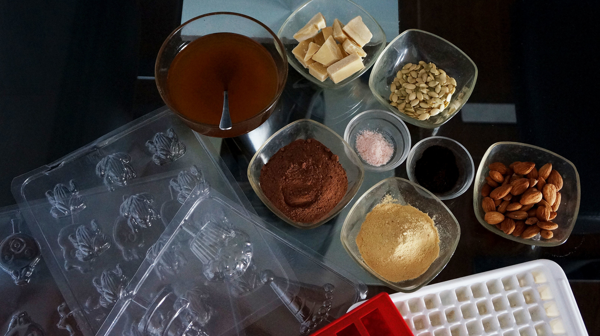 Use simple ingredients to get started: Cacao Butter, Cacao Powder, Sweetner, Salt, Nuts