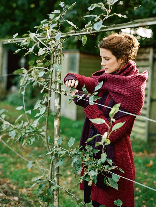 Espalier_woman_knit_sweater_tending.jpg