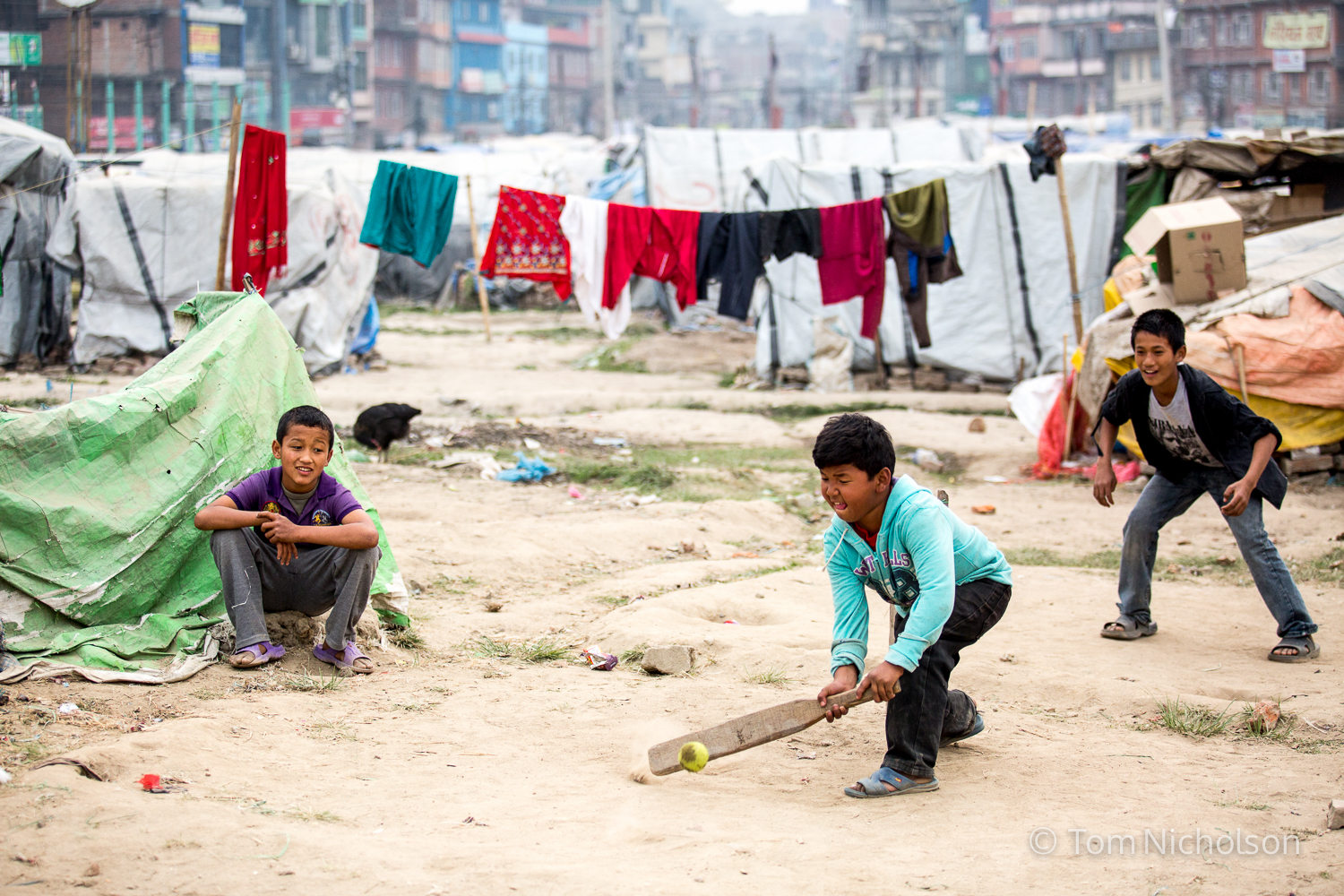 Children play cricket in the Internally Displaced Person (IDP) camp in Chuchepati, Kathmandu City, Nepal on 27 March 2016. The camp houses people in temporary accomodation due to the April 2015 earthquake.