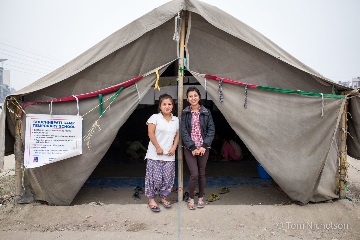 School teachers Binita Rai (left) and Bidhya Khatri at their school called The Chuchepati Camp Temporary School, located in the Internally Displaced Person (IDP) camp in Chuchepati, Kathmandu City, Nepal on 27 March 2016. The camp houses people in temporary accomodation due to the April 2015 earthquake.