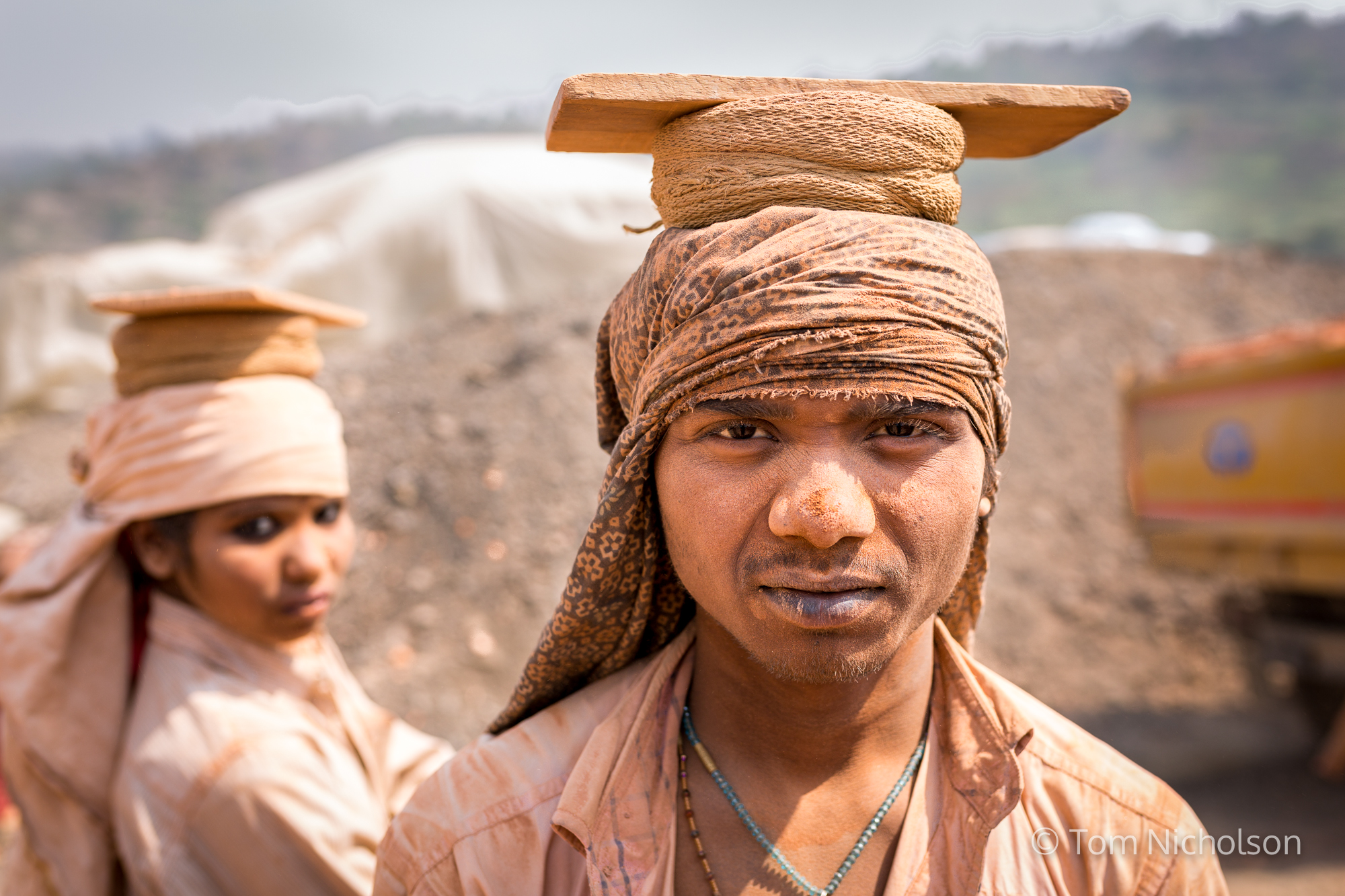 Labourers carry bricks in the UK brickworks factory in Bungamati, Kathmandu, Nepal on 15 March 2016. Around 400 labourers, including children, work in very dusty and hot conditions.