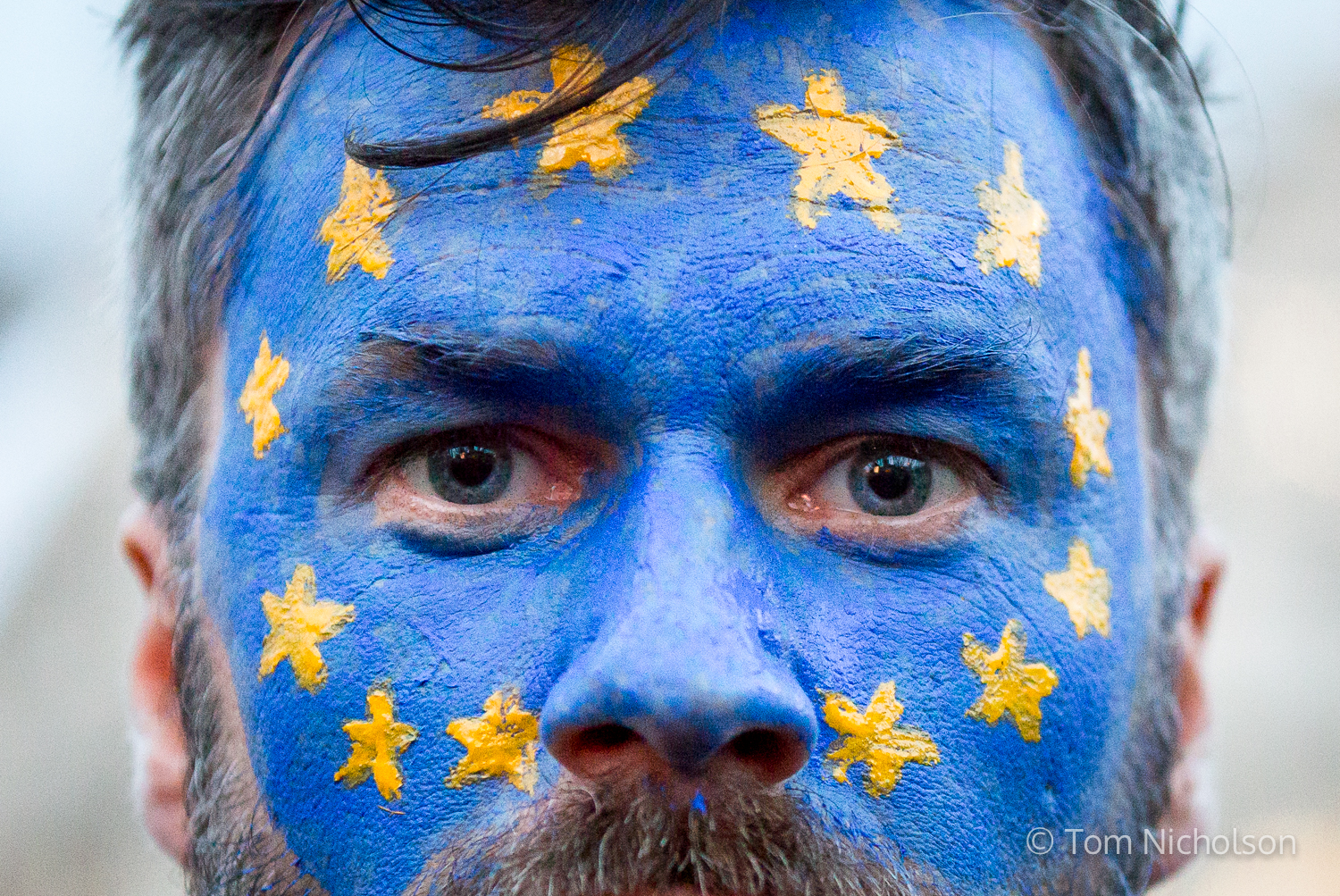 ©2017 Tom Nicholson. 20/02/2017. London, UK. A demonstrator with his face painted with the European Union (EU) flag protests against Donald Trump, whilst parliament debate a petition calling for the US President's state visit to the UK to be cancelled.