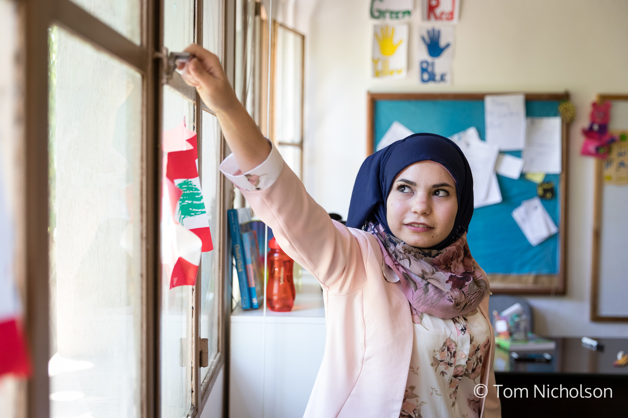 """©2018 Tom Nicholson. 20/06/2018. Beirut, Lebanon. Rasha Rafai, age 23, from Syria, is a school teacher in Bekaa, Lebanon. After leaving Syria due to the war, she couldn't afford to continue her education and was not able to work due to residency permits. Rasha then studied a Childhood Education course after receiving a SPARK scholarship, but could not find a job as a teacher, she believed due to her nationality. After this, the institute where she studied offered her a job offered her a job as a school teacher. Rasha says: """"For me, education is everything. It is the key to a new life."""" She hopes to return to Syria, to teach the children and use her new skills."""