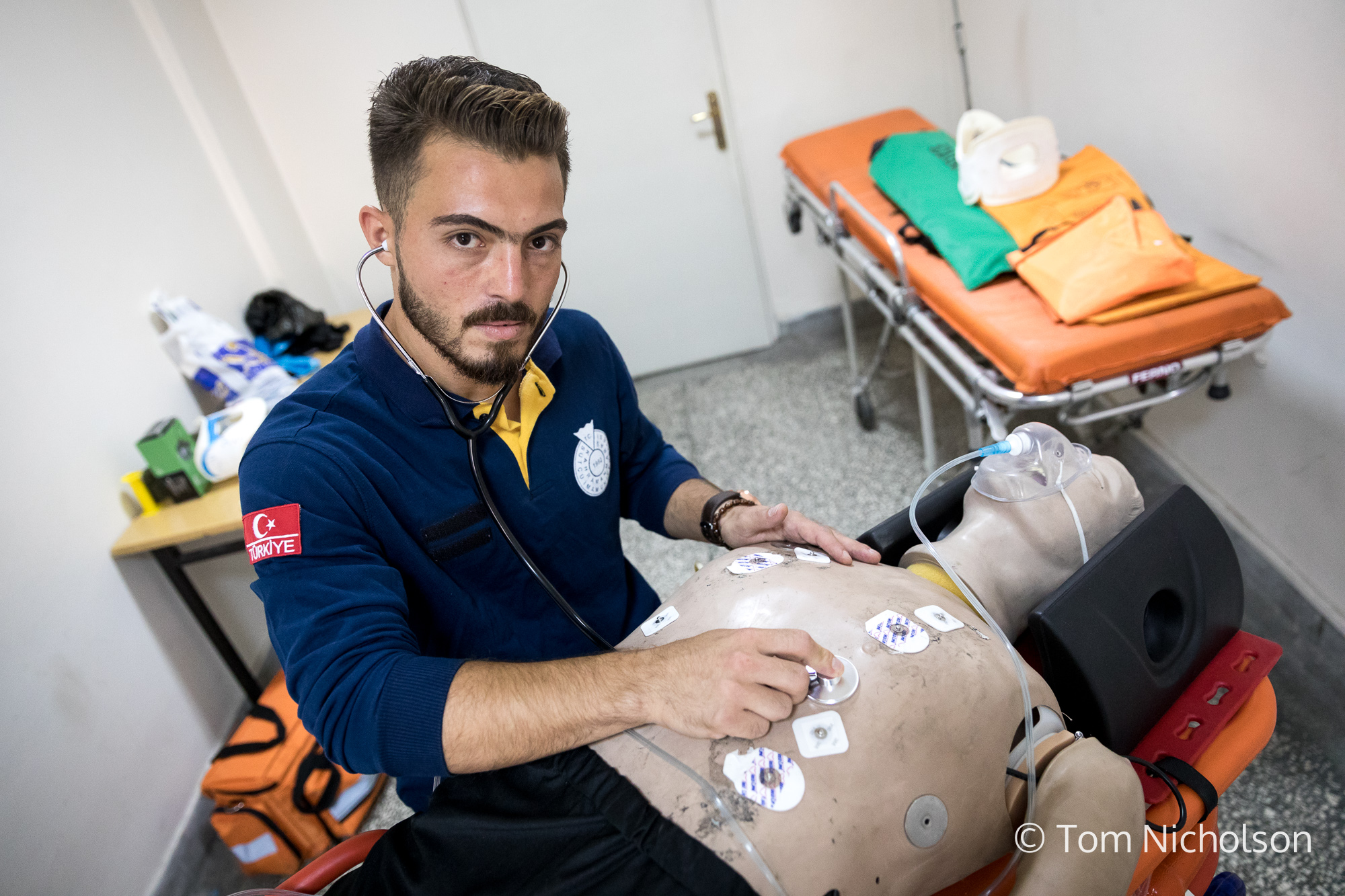 ©2018 Tom Nicholson. 02/07/2018. Kahramanmaraş, Turkey. Muhammed al-Najjar, age 24, from Aleppo in Syria is studying to become a Paramedic at Sütçü Imam University in Turkey. He was previously studying in Aleppo whilst also running his father's shoe factory, but was forced leave due to heavy shelling. Whilst he was living with his family in a refugee camp in Turkey, the Turkish Red crescent came to help, which inspired him to volunteer and then to go on to become a paramedic. He is inspired by people such as Razan al-Najjar, a Palestinian paramedic who was killed by the Israeli Defence Forces whilst volunteering as a medic during a Gaza border protest. Muhammed plans to work as a paramedic in Syria or Palestine in the future.