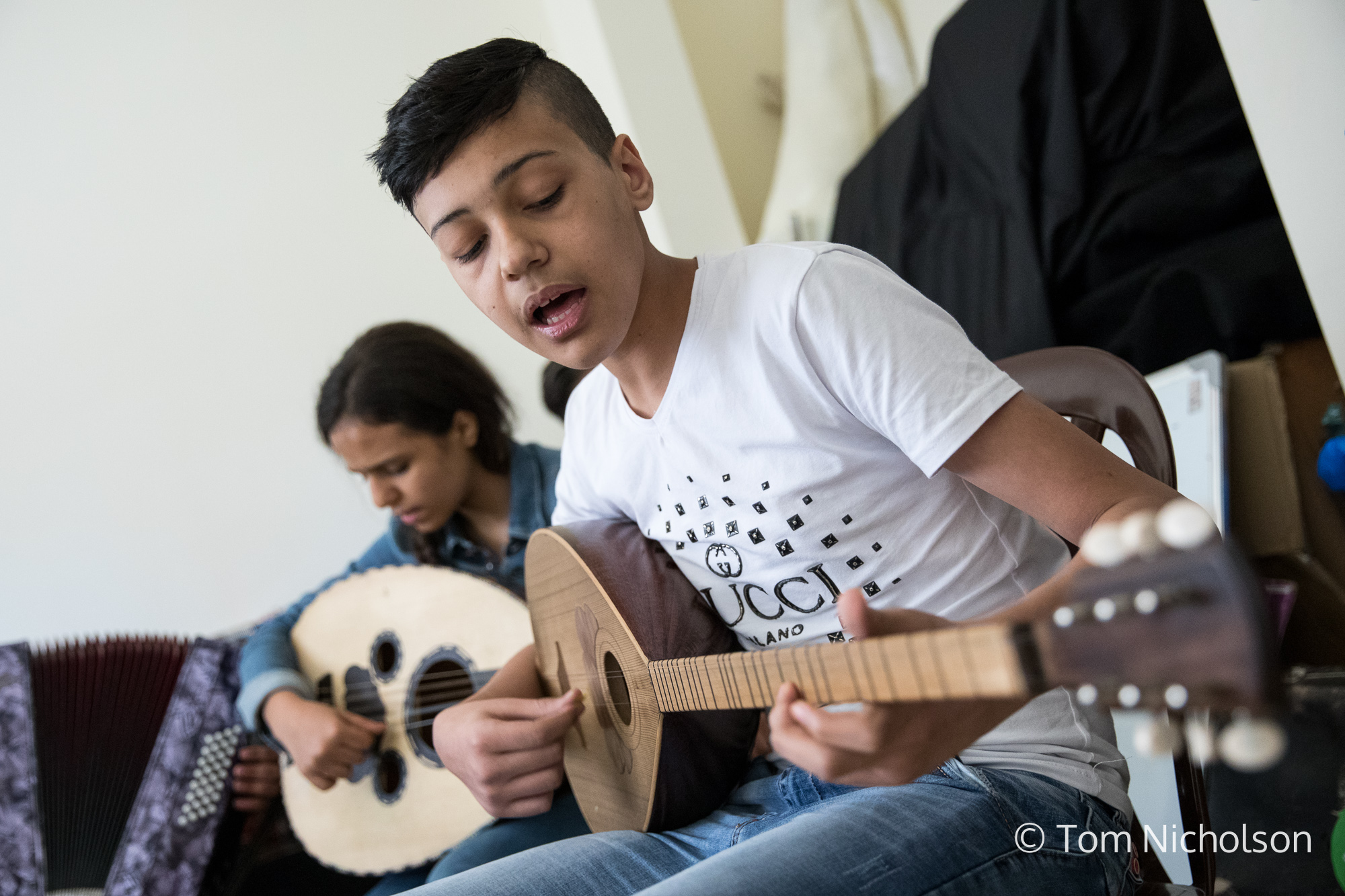 ©2018 Tom Nicholson. 20/06/2018. Bekaa Valley, Lebanon. A student from the Action for Hope centre in Bekaa Valley, Lebanon plays traditional Arab folk music.