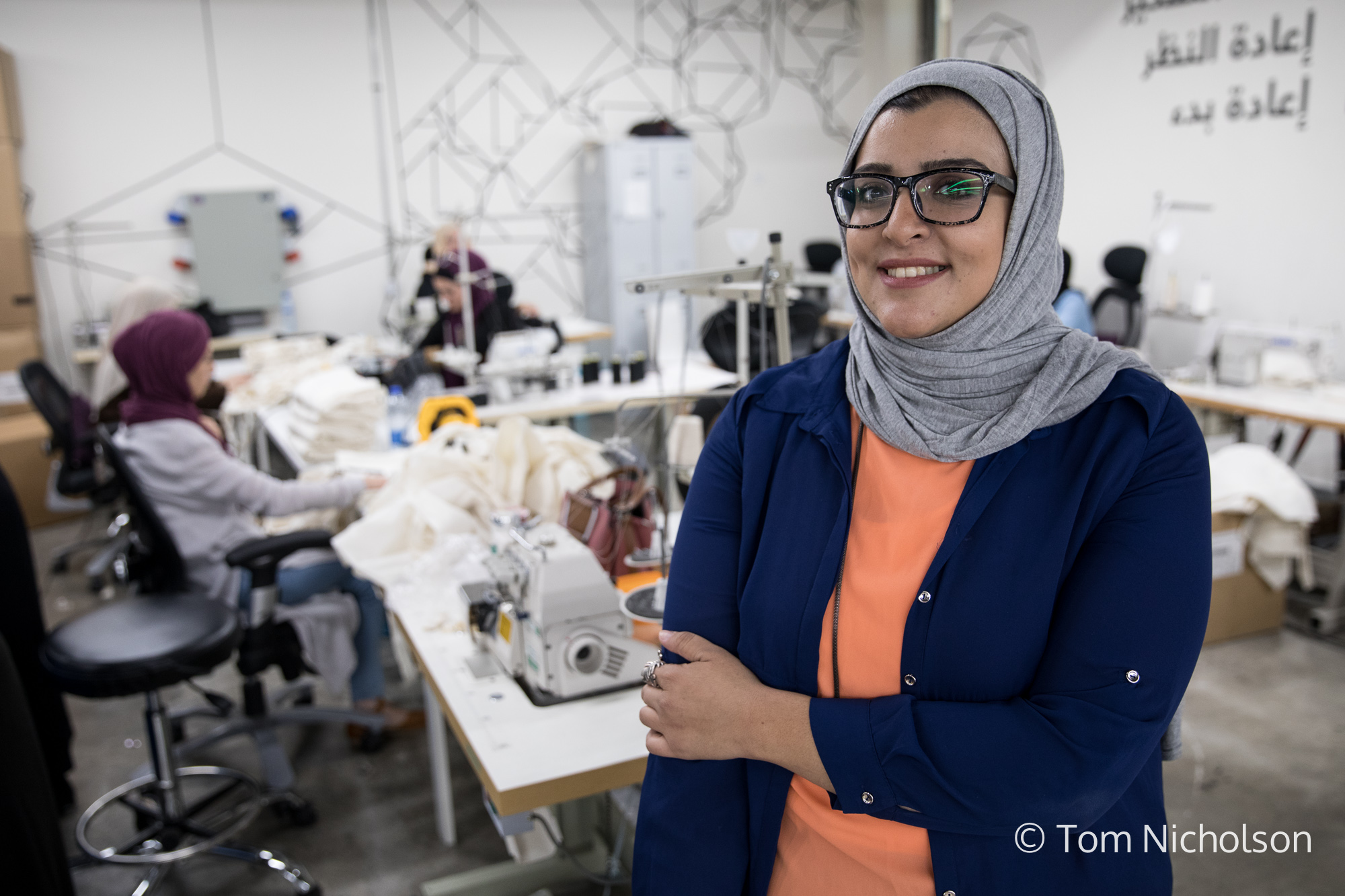 ©2018 Tom Nicholson. 23/06/2018. Irbid, Jordan. Raneem Faisal is the Co-Founder of Teenah, a social manufacturing company producing tote bags. The company provides support and work to vulnerable Syrian and Jordanian women who have often lost their husbands or the male breadwinner to the war, and therefore need an income to provide for their families. Asya lost 8 of her family members when their house was hit by a bomb during the war in Syria. Now thanks to Teenah, she has been able to afford to give her children a good education.