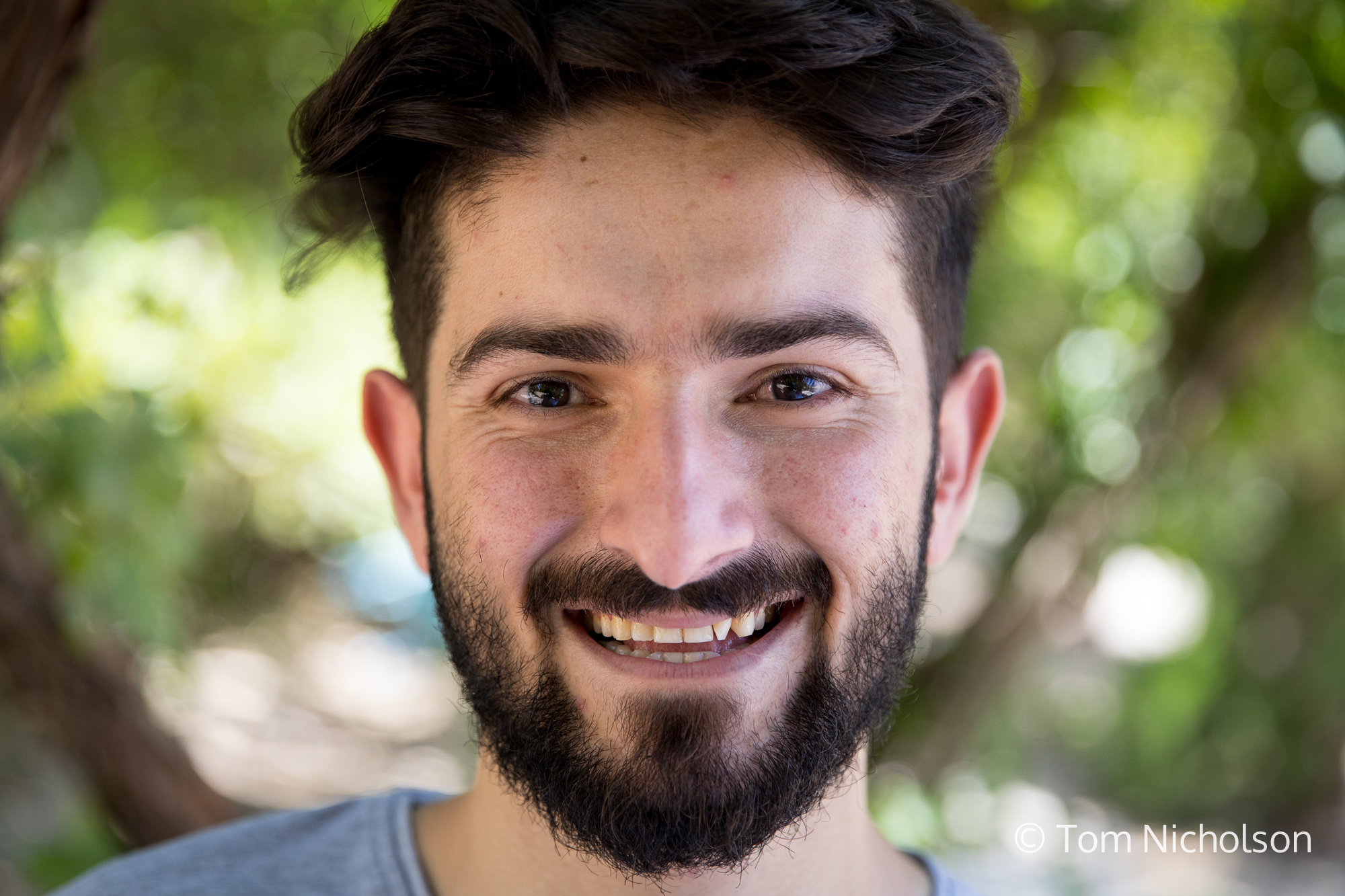 """©2018 Tom Nicholson. 27/06/2018. Erbil, Iraq. Bawar Muhammed, age 22, from Iraqi-Kurdistan has set up a service that links Iraqi Kurds to opportunities to study abroad or apply for grants and scholarships. Bawar quoted Nelson Mandela: """"The most powerful weapon to change the world is education"""". Bawar works on the the 'Boost Your Beliefs' (BYB) counter-radicalisation programme. The programme focuses on countering online radicalisation by storytelling, campaigning and sending alternative messages. It aims to direct young people to education and job opportunities, paving the way for a future workforce and subsequently reducing the risk of future radicalisation and violent extremism."""