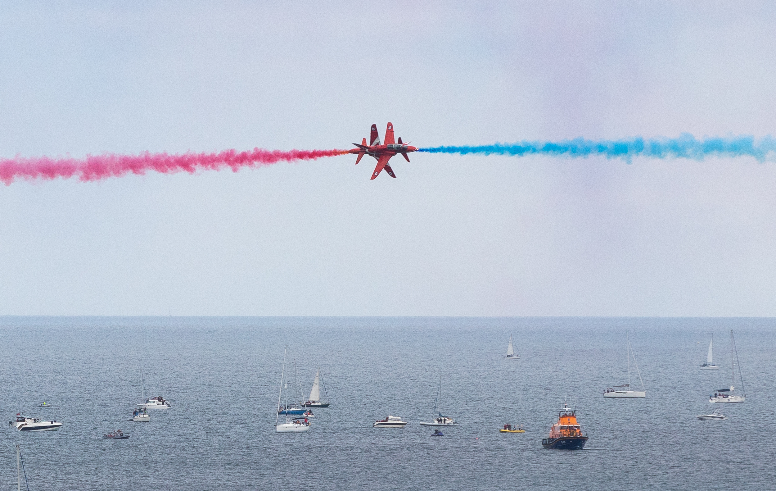 The Red Arrows perform a display as part of Falmouth Week in Cornwall. Large crowds are expected, as 45,000 people watched last year. August 2018, Falmouth, UK.
