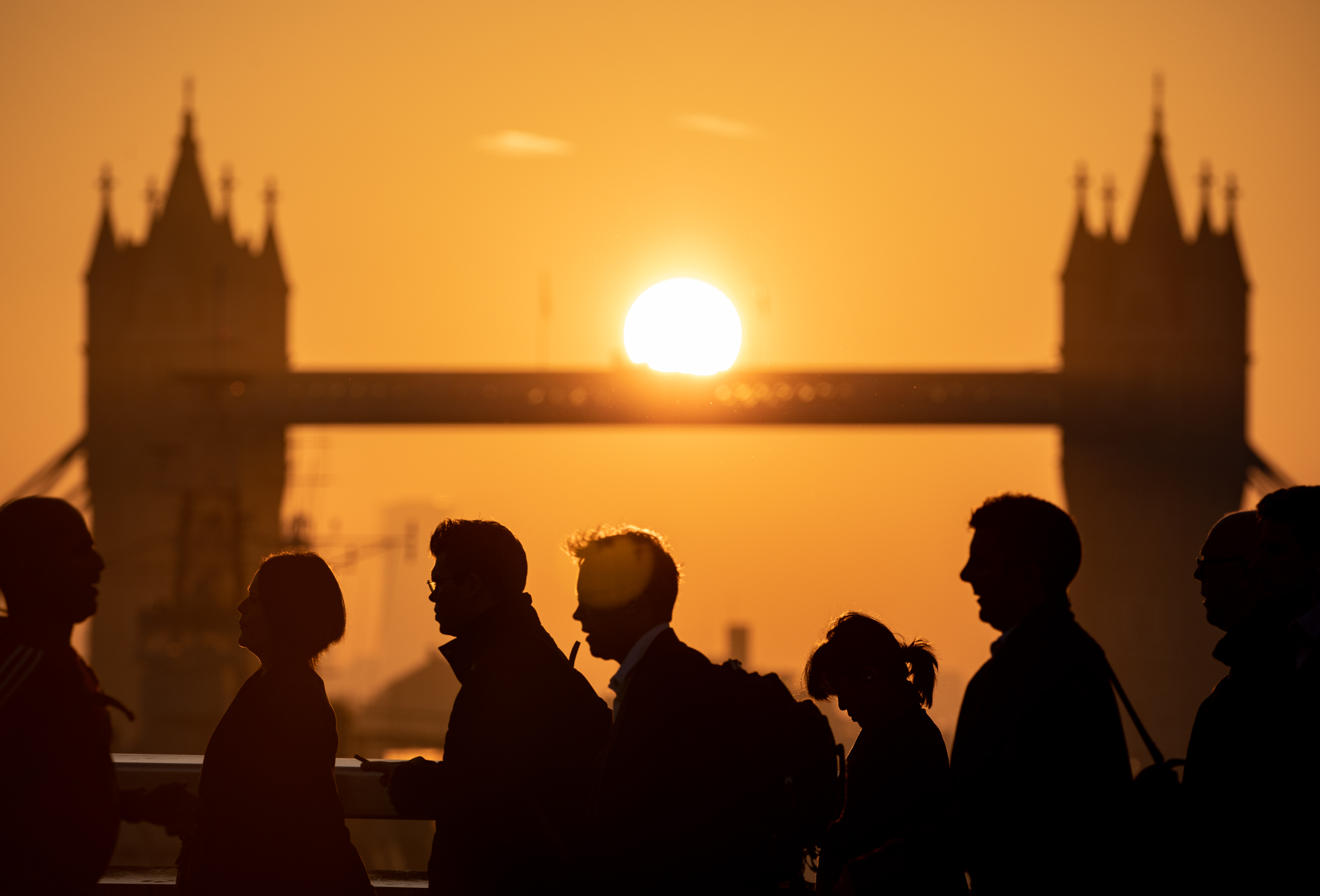 The sun rises through Tower Bridge in London, as the capital expects unseasonably warm weather later in the day, with temperatures set to reach up to 23 degrees Celsius. October 2018 - London, UK.