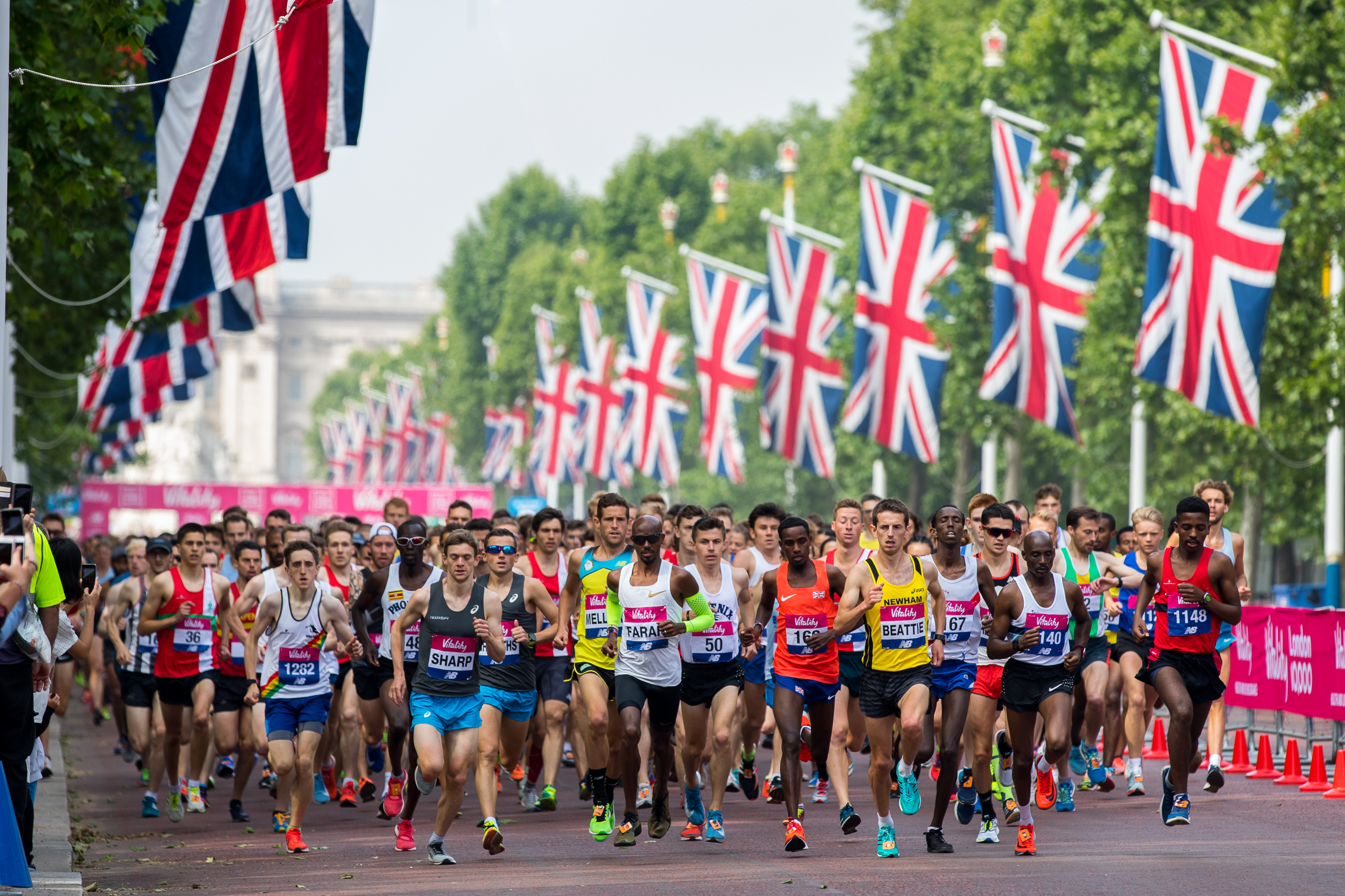Mo Farah (centre, white vest) runs in the the Vitality 10KM race in central London. He later went on to win the race. May 2018 - London, UK.