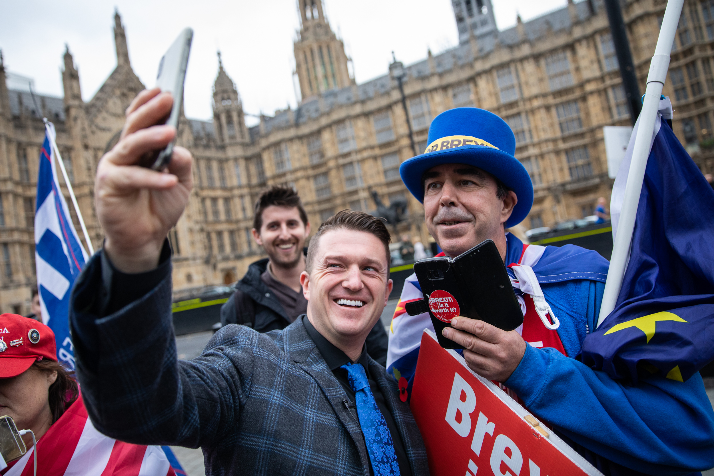 Stephen Yaxley-Lennon, also known as Tommy Robinson, (left) takes a selfie with prominent anti-Brexit campaigner Steve Bray (right) in Westminster. November 2018 - London, UK.