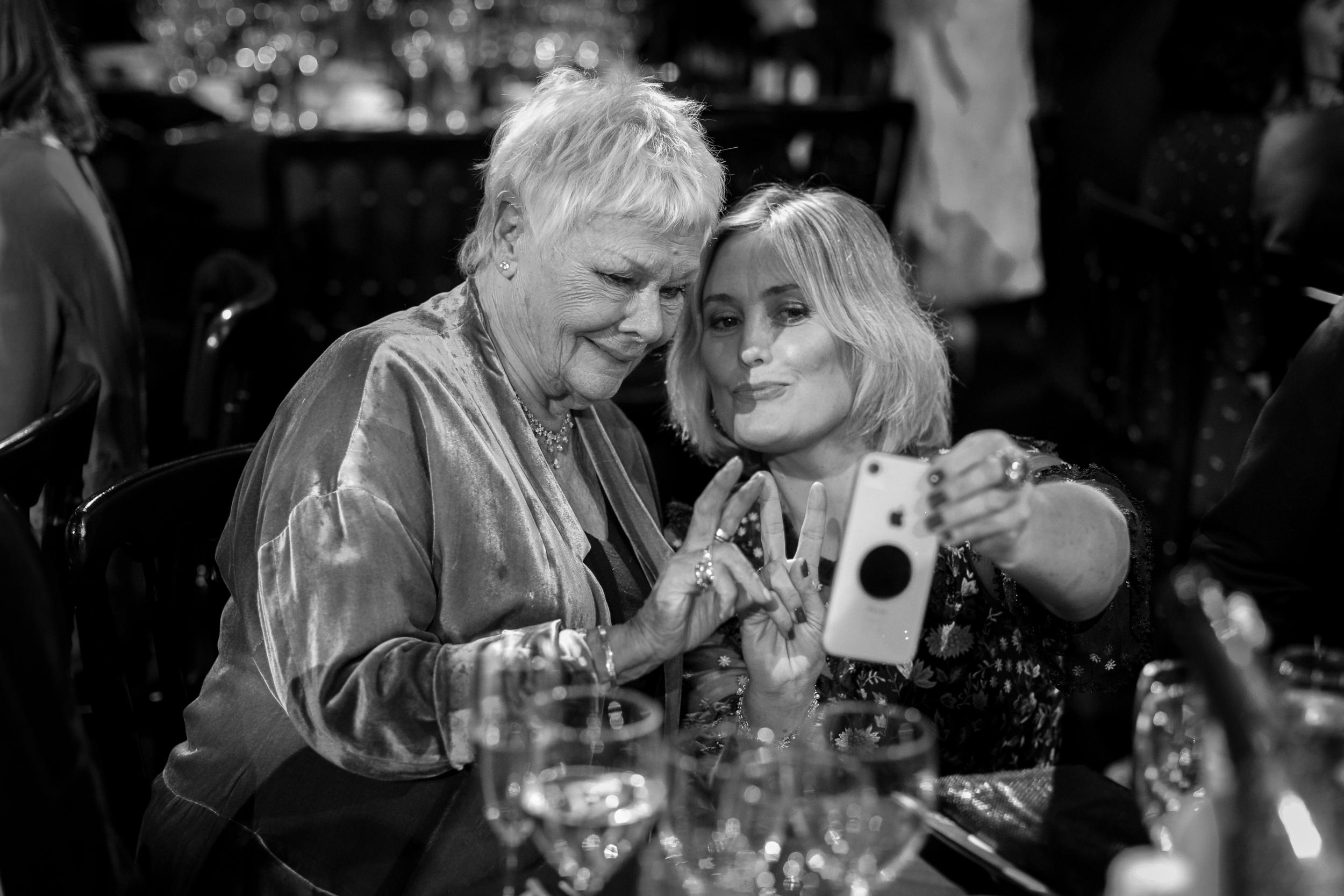 Judi Dench takes a selfie at the 2018 British Independent Film Awards at Old Billingsgate. December 2018 - London, UK.