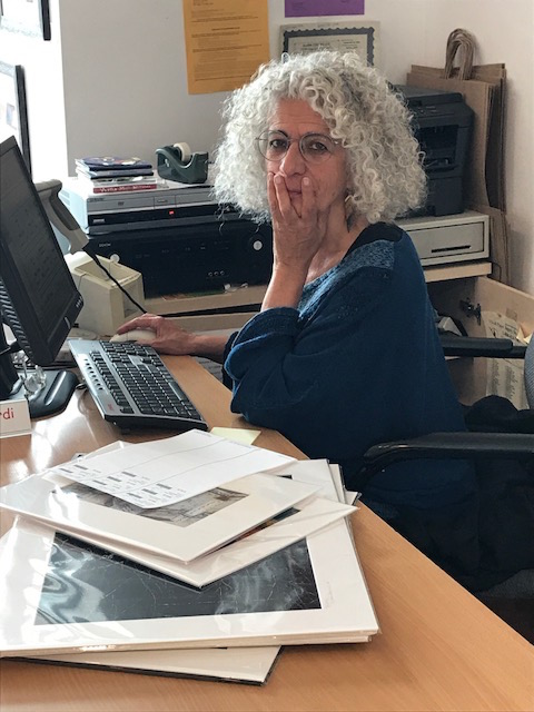 I could not resist posting this photo of Happy (L.A.) Hyder helping us on the desk. Hyder's photography is a must see!