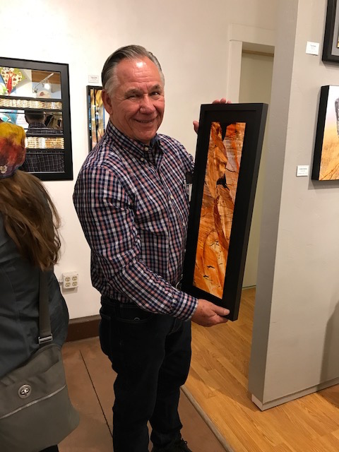 Steve Chell getting ready to bubble wrap one of his pieces from his photographic art collection for a customer/art collector.