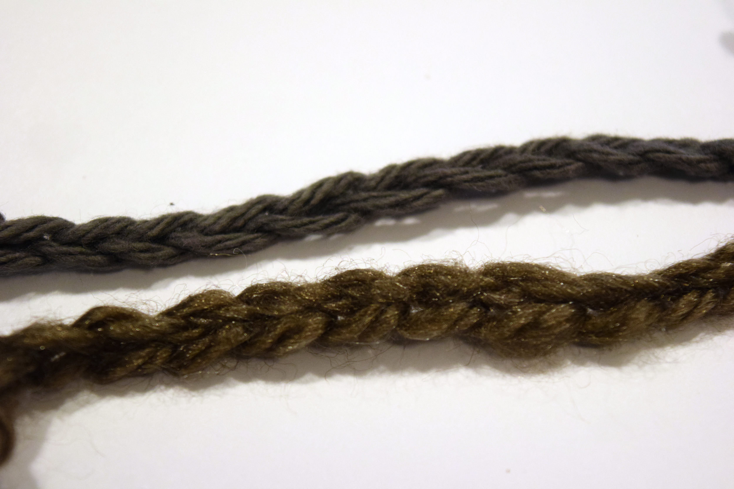 A comparison of chain stitches on the first yarn I bought (below) and the cotton yarn (above). It was MUCH easier to make out the individual stitches in the cotton.