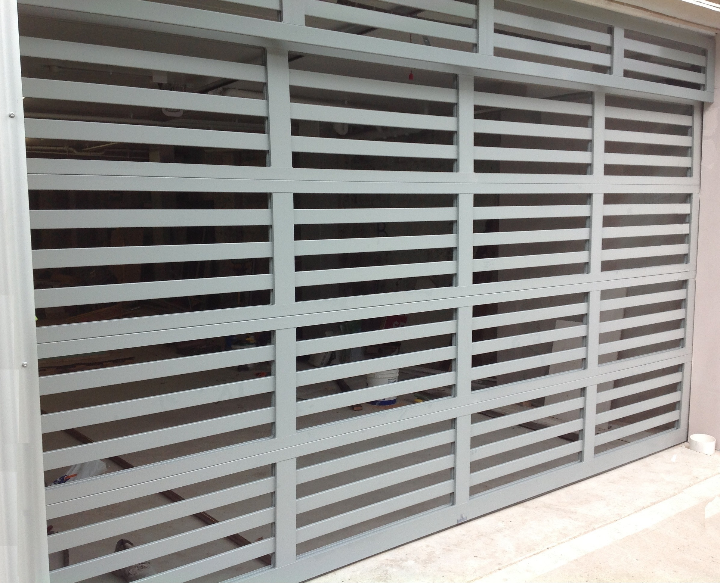 Custom Powder Coated Aluminium Batten Sectional Door (one click on image to enlarge)