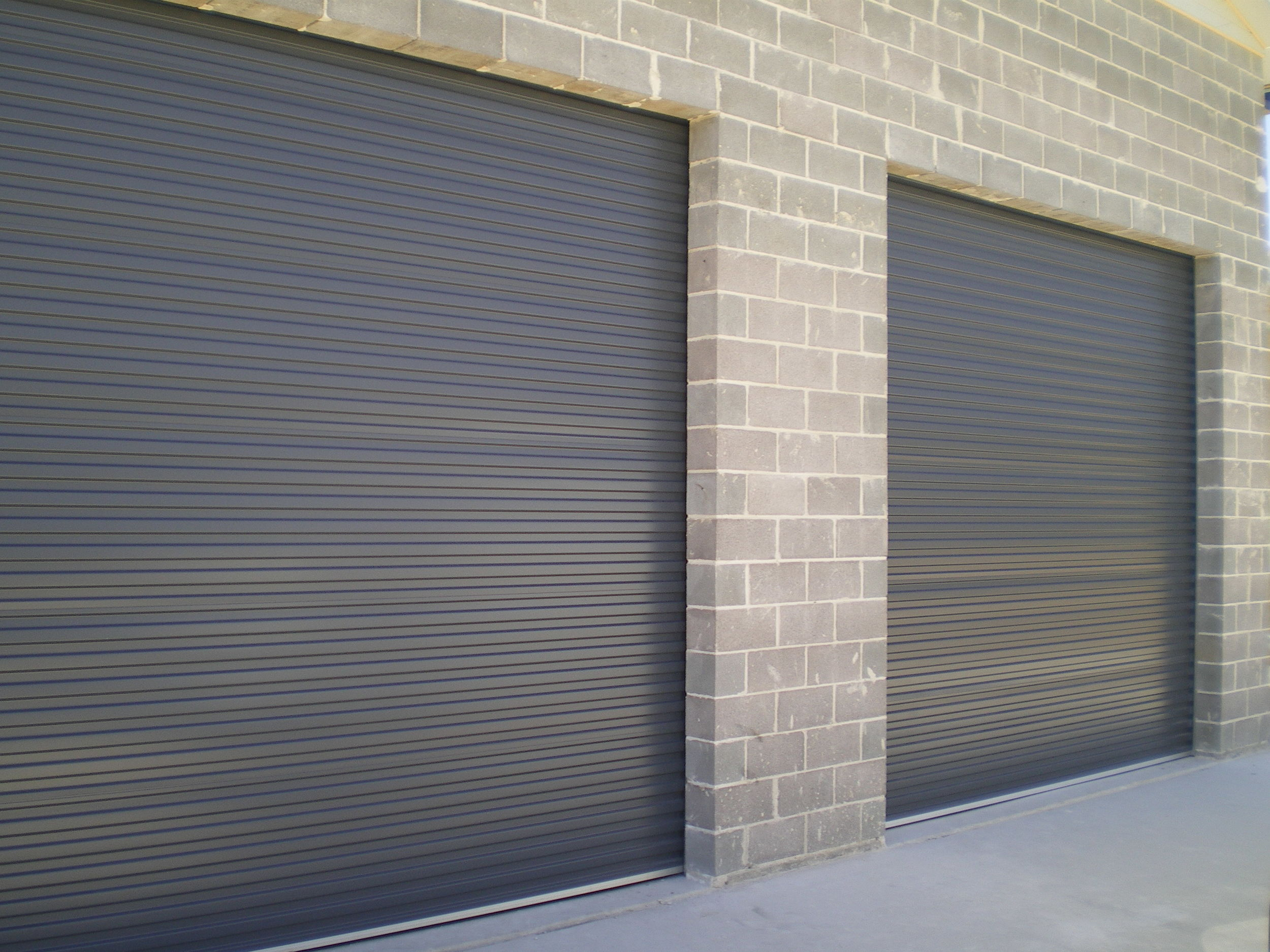 Industrial Roller Doors are .55g BlueScope steel and for extra strength we can provide 65mm deep door guides.