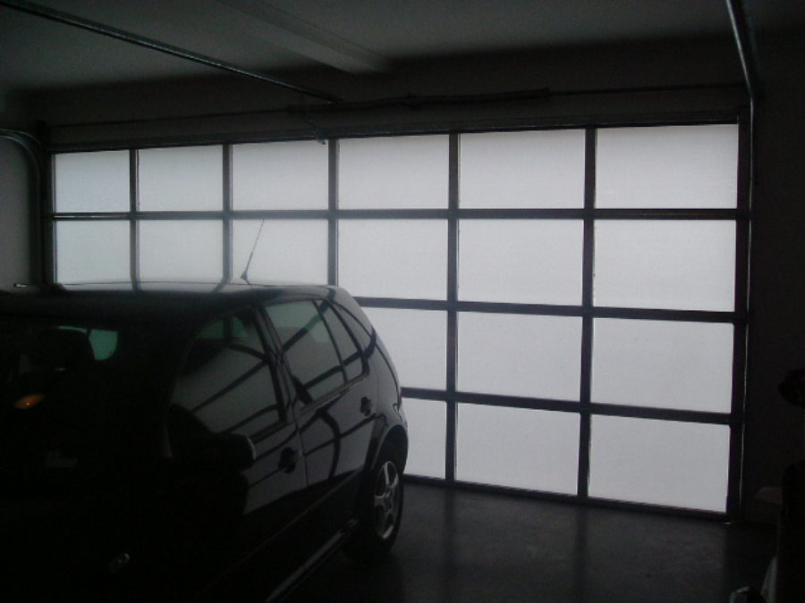 Custom aluminium door with opal translucent inserts (click on image to enlarge)