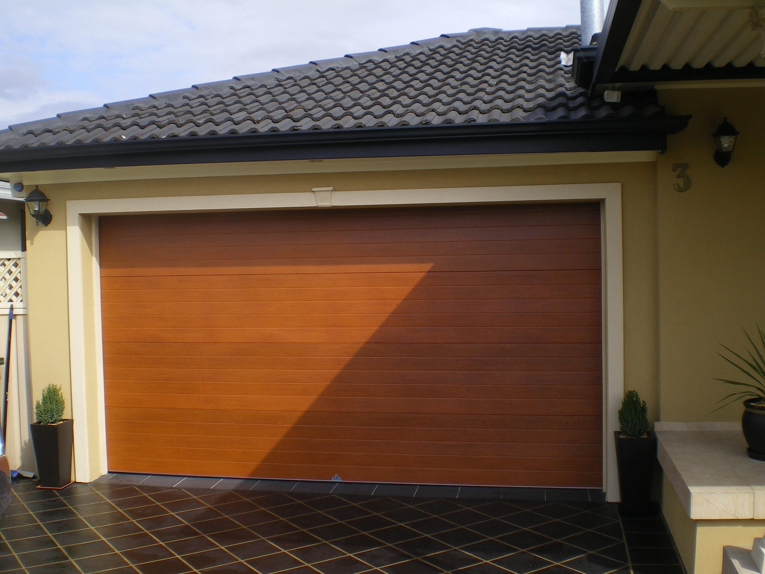 """""""knotwood"""" Australian cedar steel sectional door (click on image to enlarge)"""