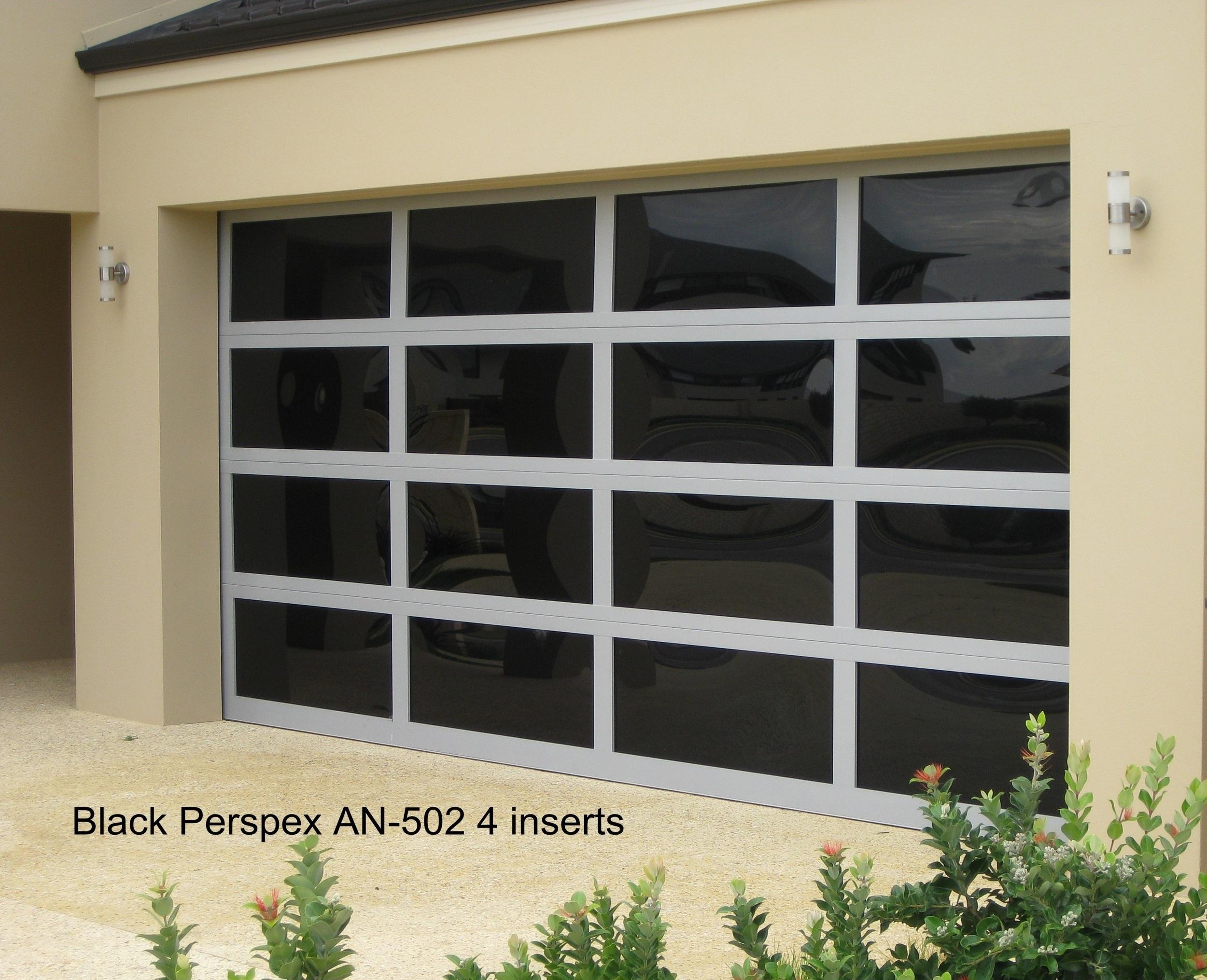Custom aluminium door with dark acrylic inserts (click on image to enlarge)