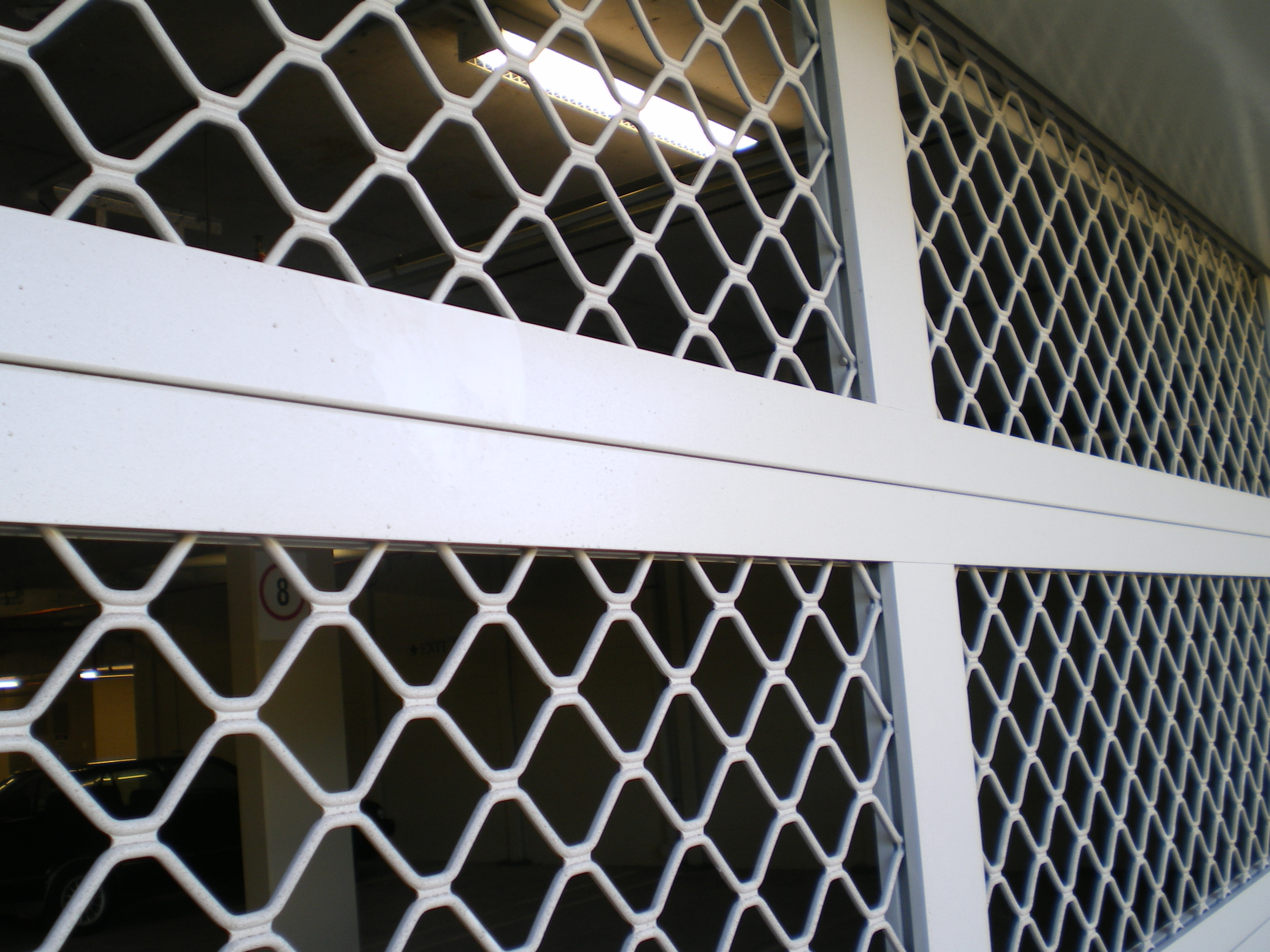 Aluminium Diamond mesh 'air flow' Sectional Door (one click on image to enlarge)