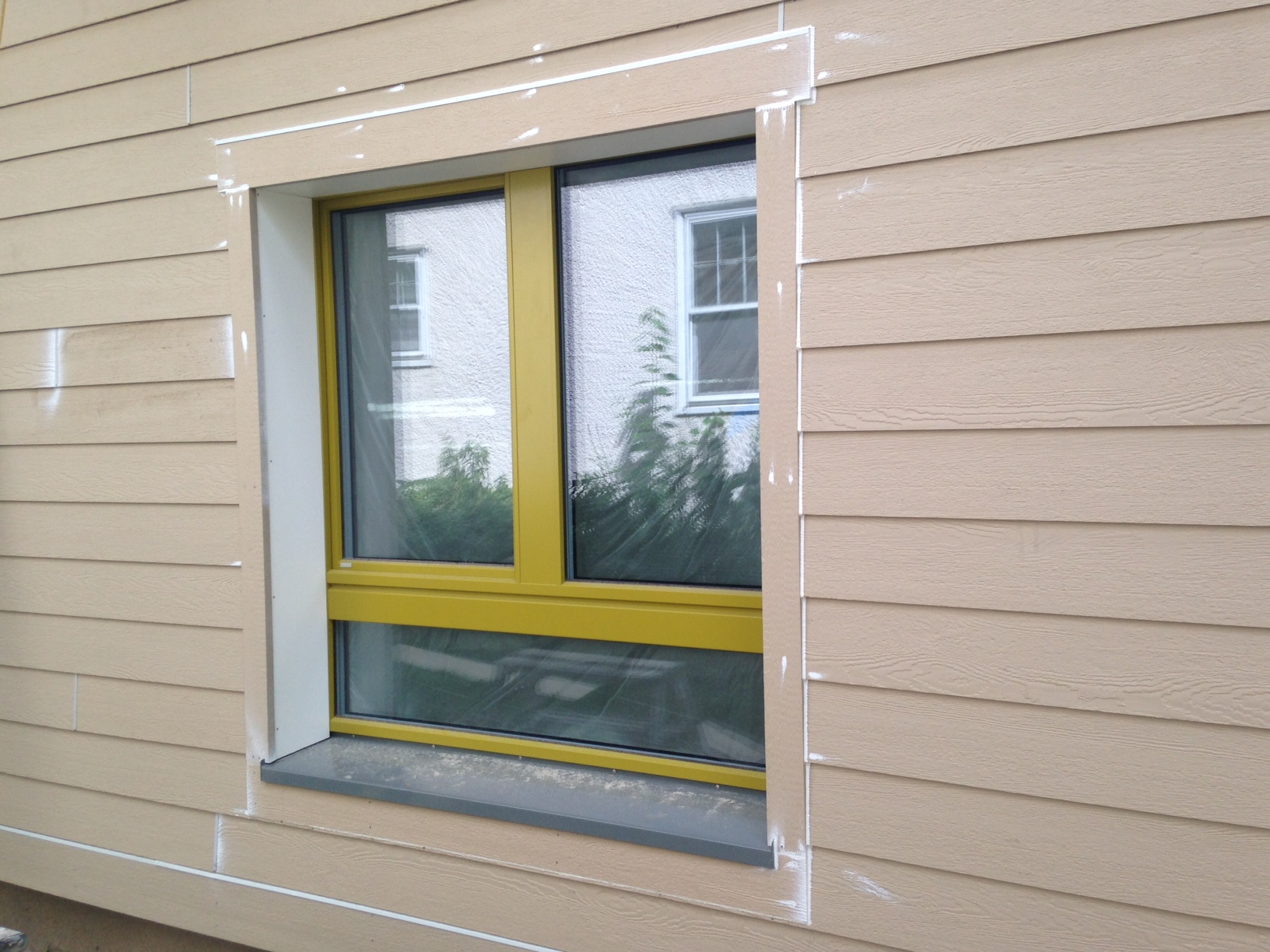 The first finished window.  Next step:  paint the trim and siding.