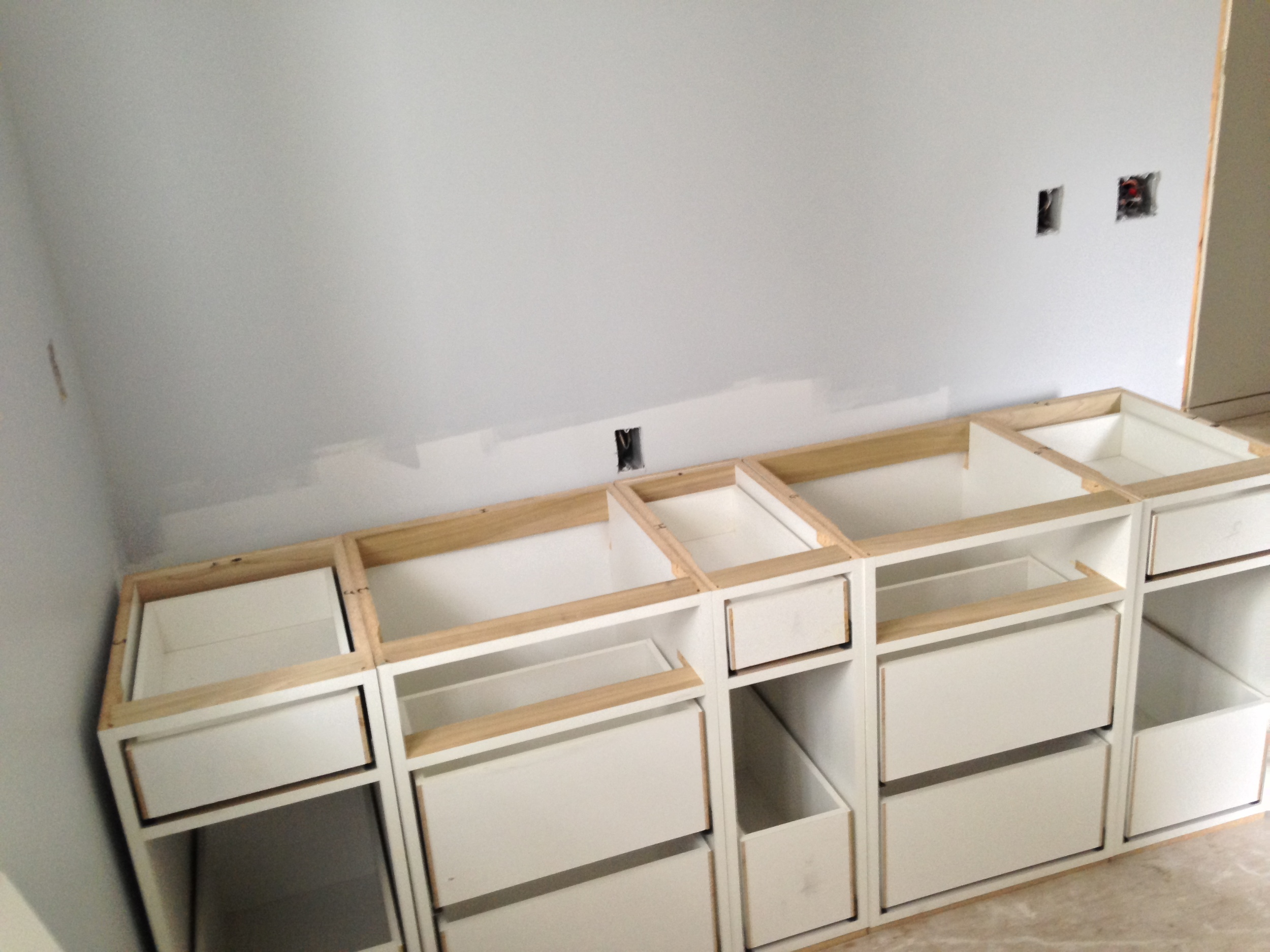 Vanity for the kids' bath, with 2 sinks, 2 pull out hampers and pull out garbage