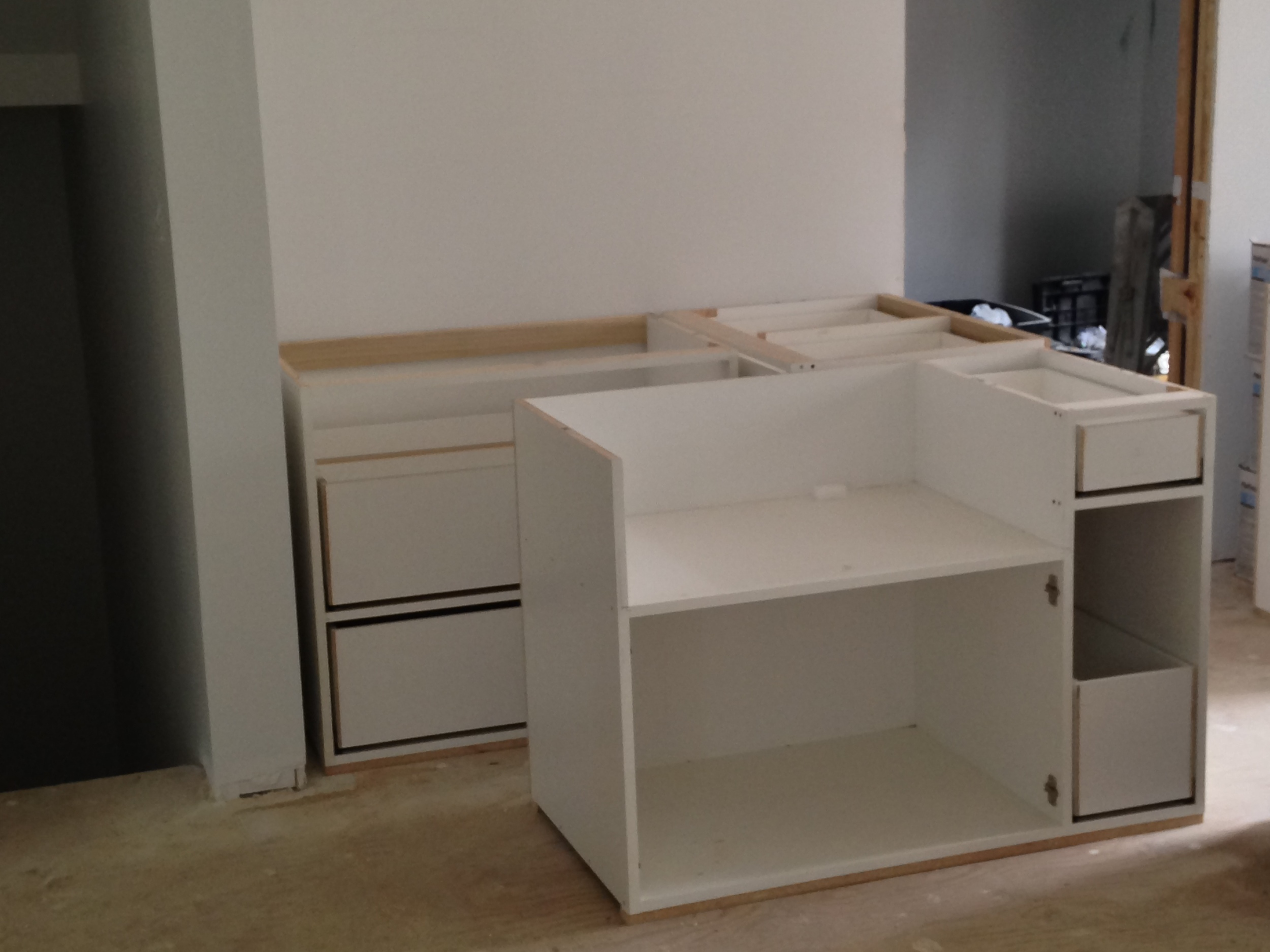 Base cabinets for the kitchen without their doors)