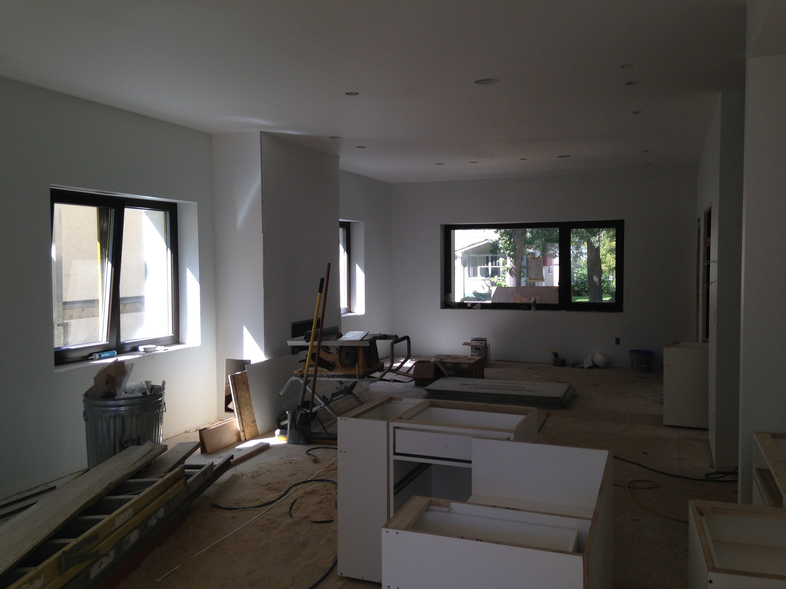 Looking toward the dining and living areas of main room with fireplace