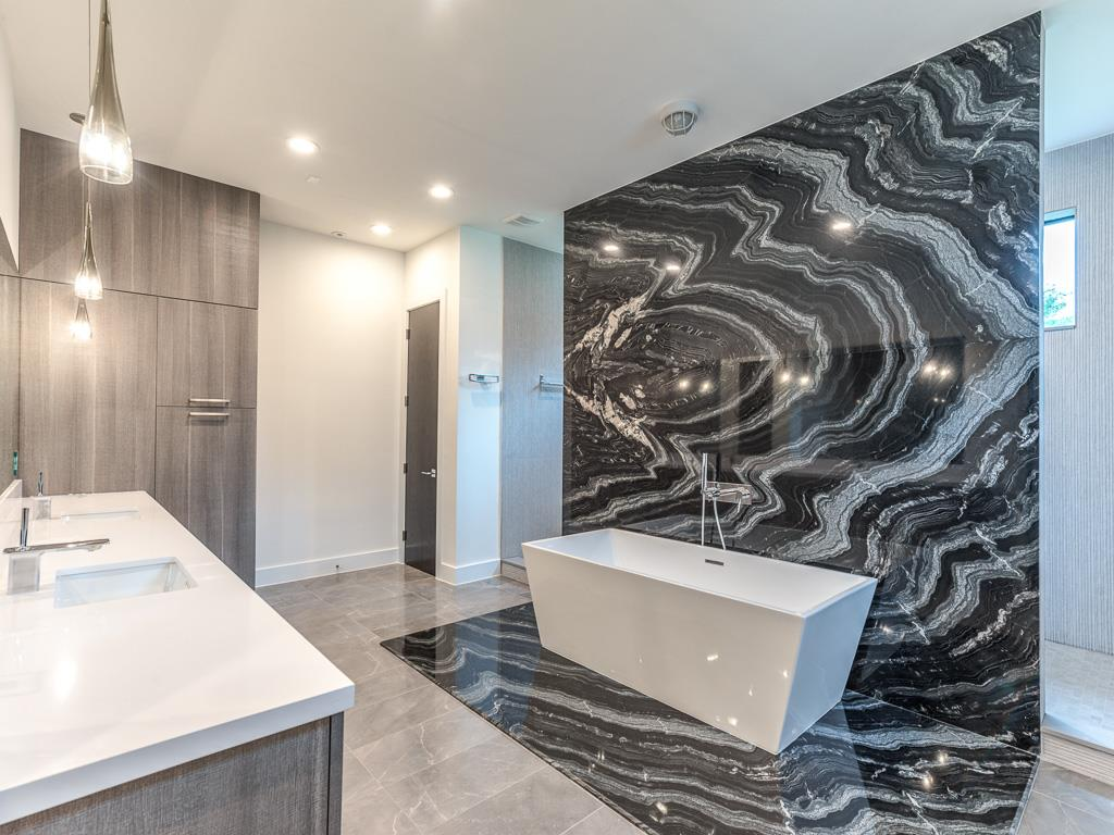 Agata Granite Bookmatched for Bathroom wall feature by Nina Magon at Contour Interior Design built by Capital Builders.