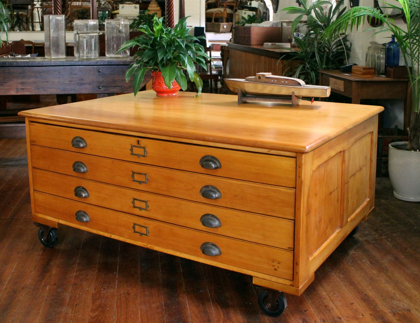 A great set of solid New Zealand Kauri Map /Plan Drawers ,circa 1900.  Made from a fine cut of of glowing golden New Zealand Kaurithese drawers are very large in size & all slide in & out beautifully . Raised on lockable castors for easy movement .  1600mm wide x 1130mm deep x 750mm height  Drawer internal measurements ; 1445mm widex 1020mm deep x 90mm high  $5850