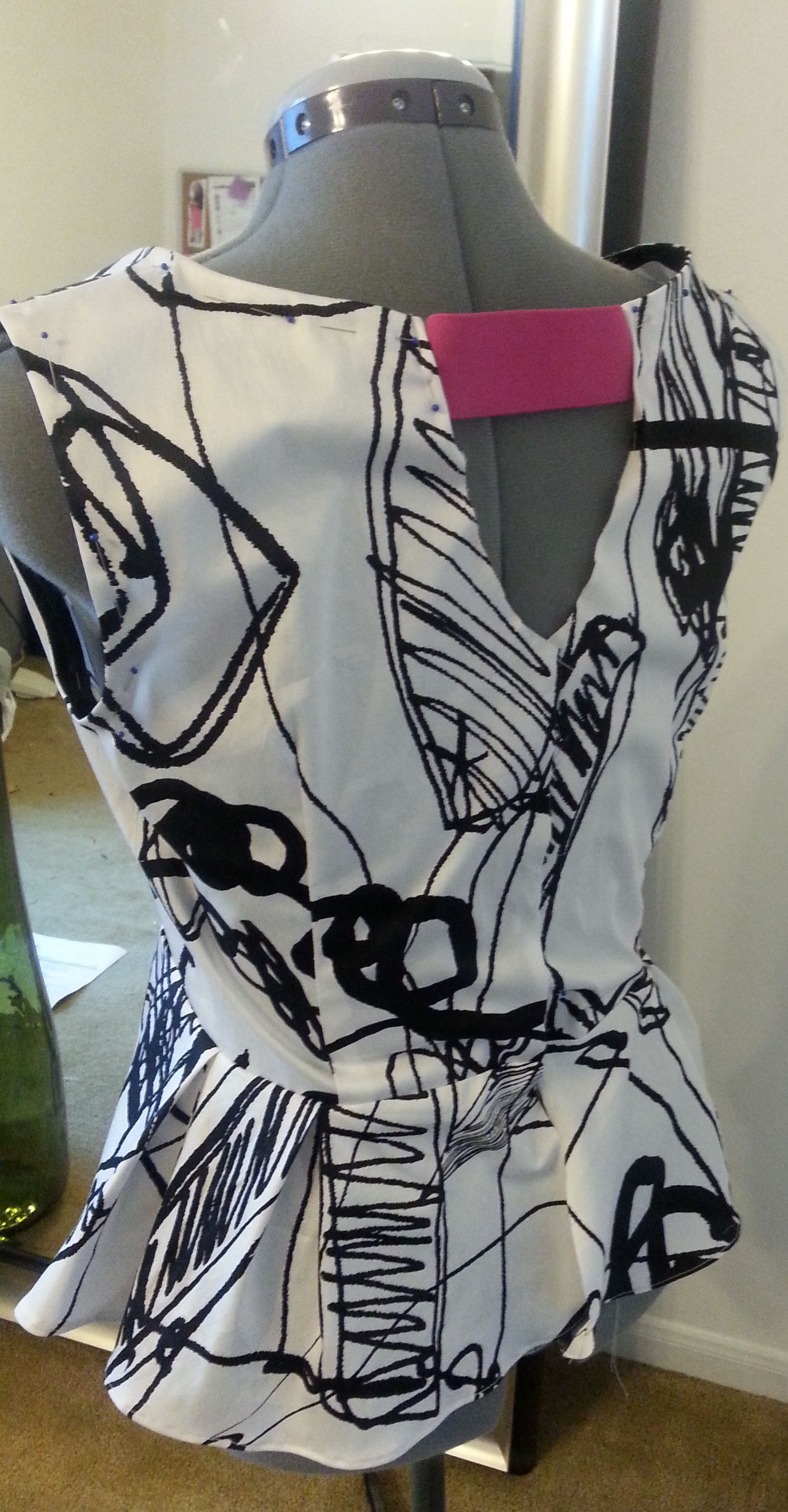 Here's the back of peplum prior to hemming, pressing, top stitching, adding zipper etc.