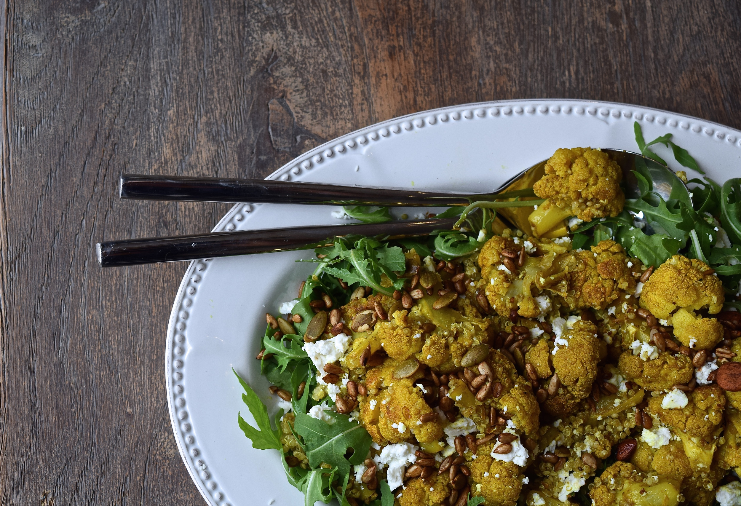 http://blog.wearetribe.co/post/124736046086/roasted-cauliflower-and-quinoa-salad-with-tribe