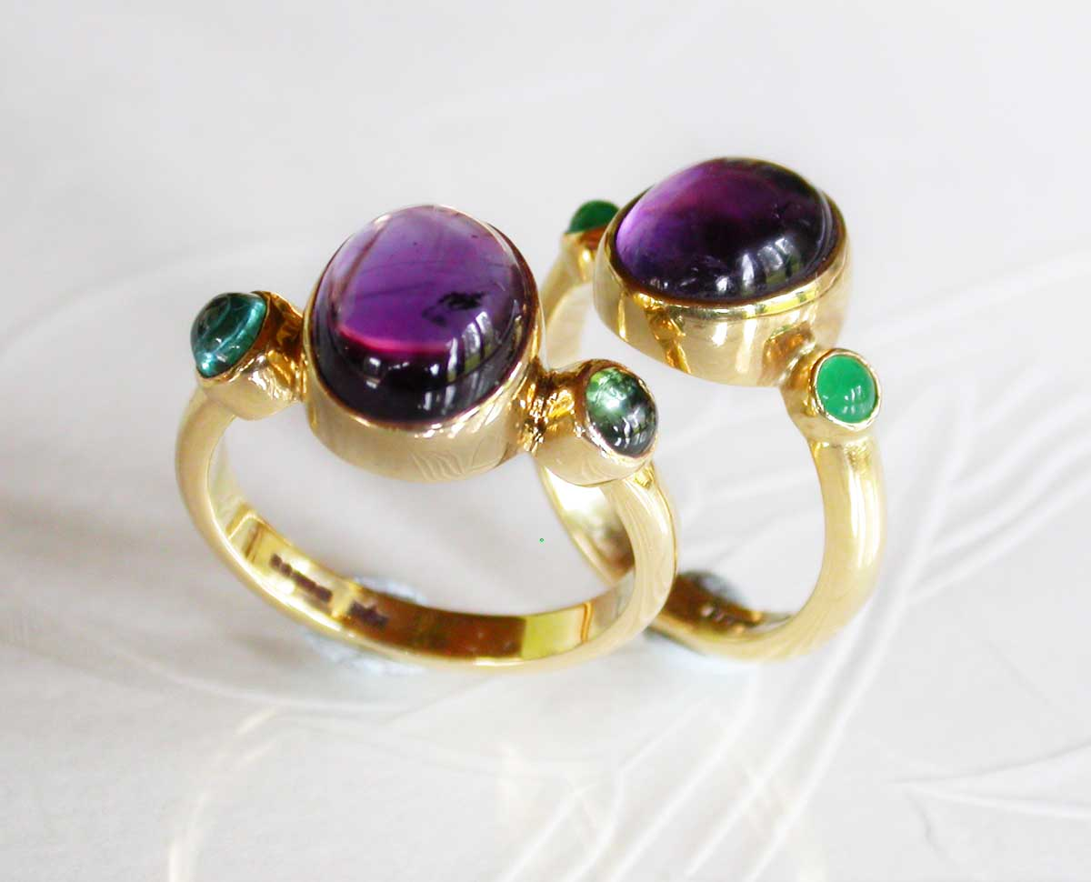 Gold rings set with oppulent precious stones