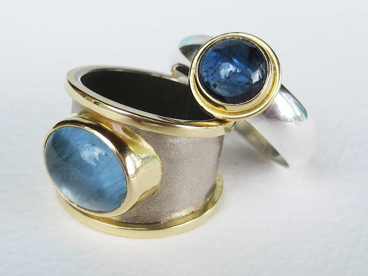 Yellow and white gold bands with aquamarine