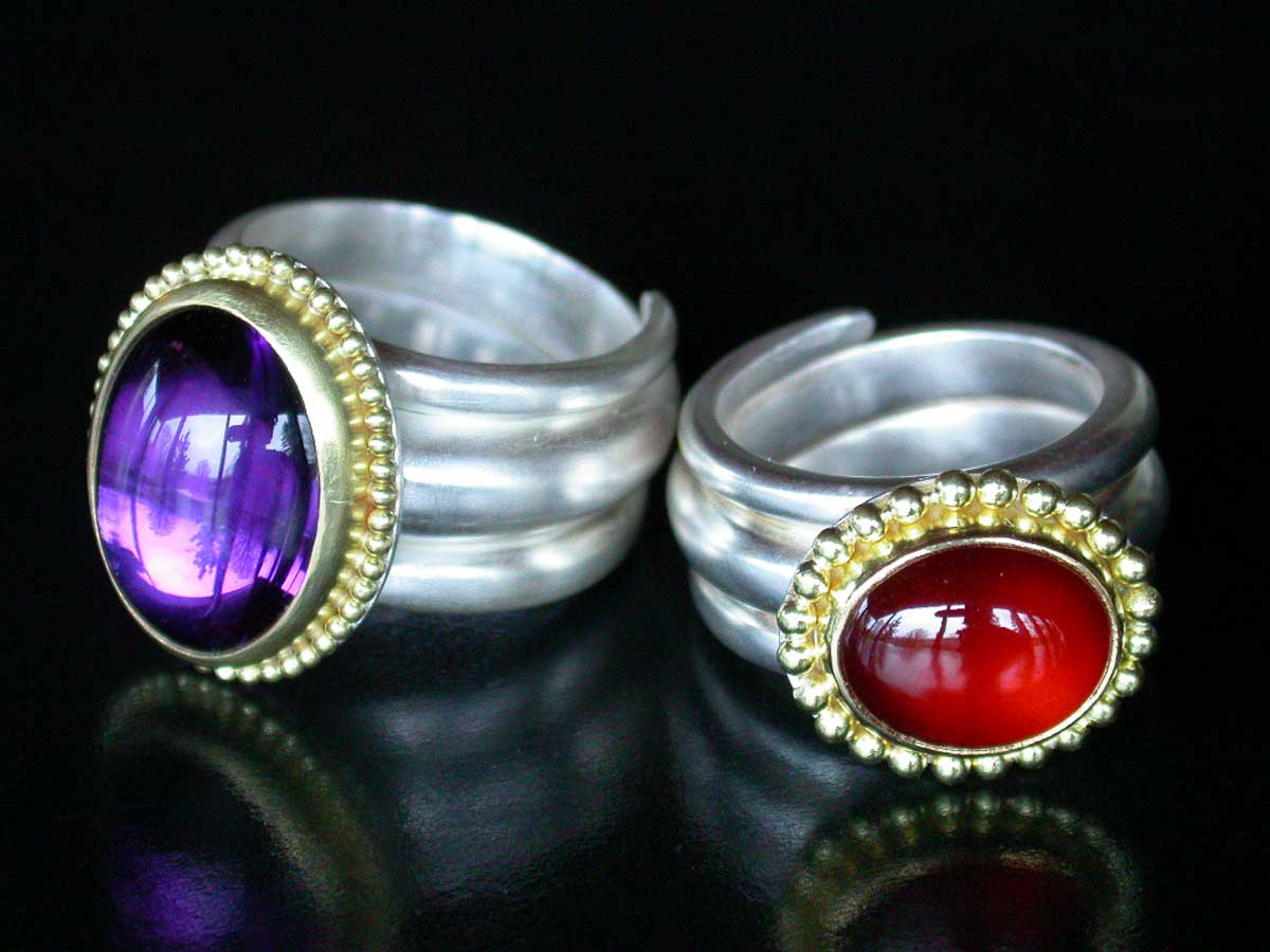 Silver and gold amethyst garnet rings