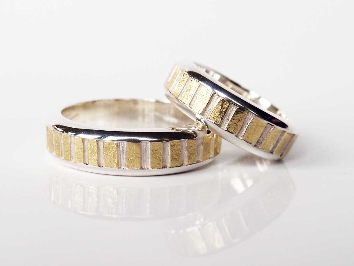 Silver and 18ct. gold rings