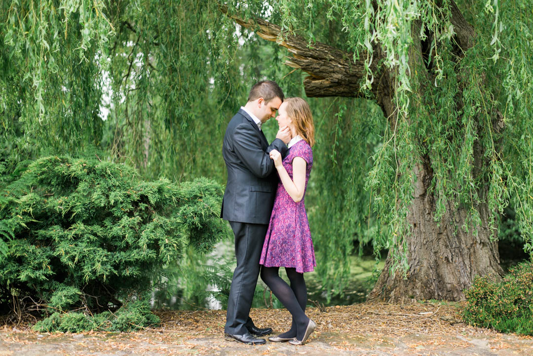 A Young Engaged Couple Standing Under the Willows at Inglewood Manor