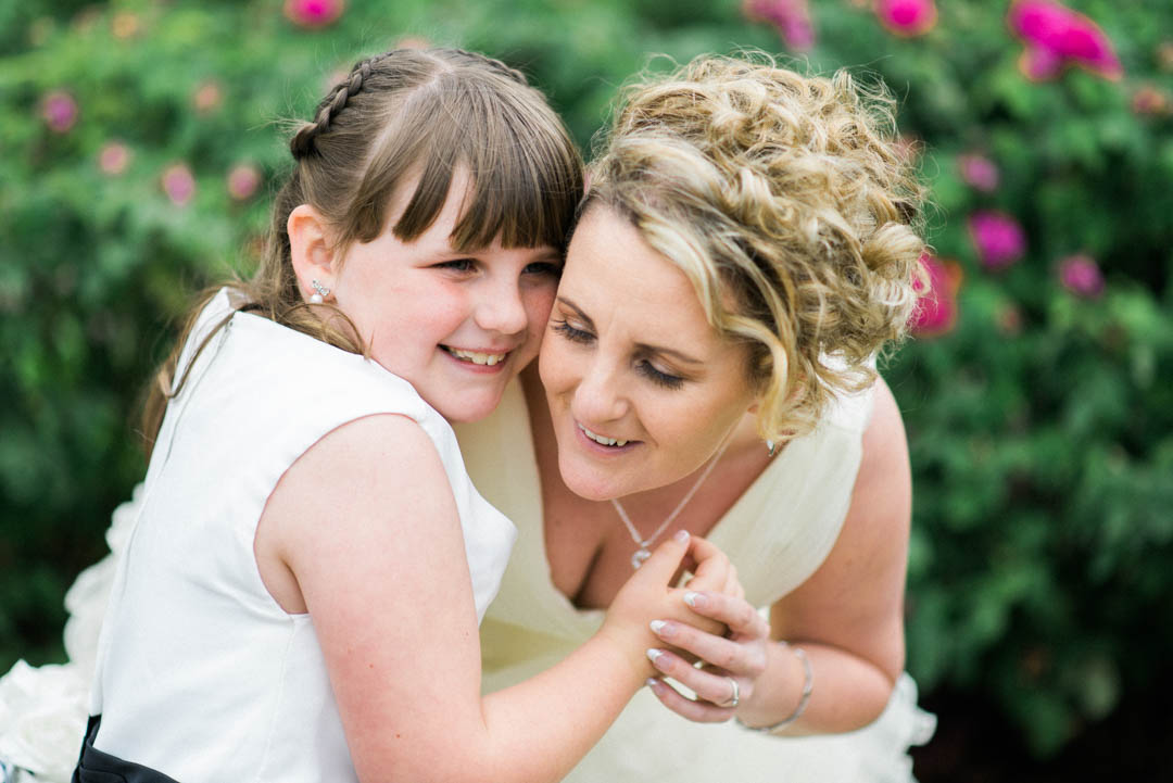 Bride and a child on her wedding day